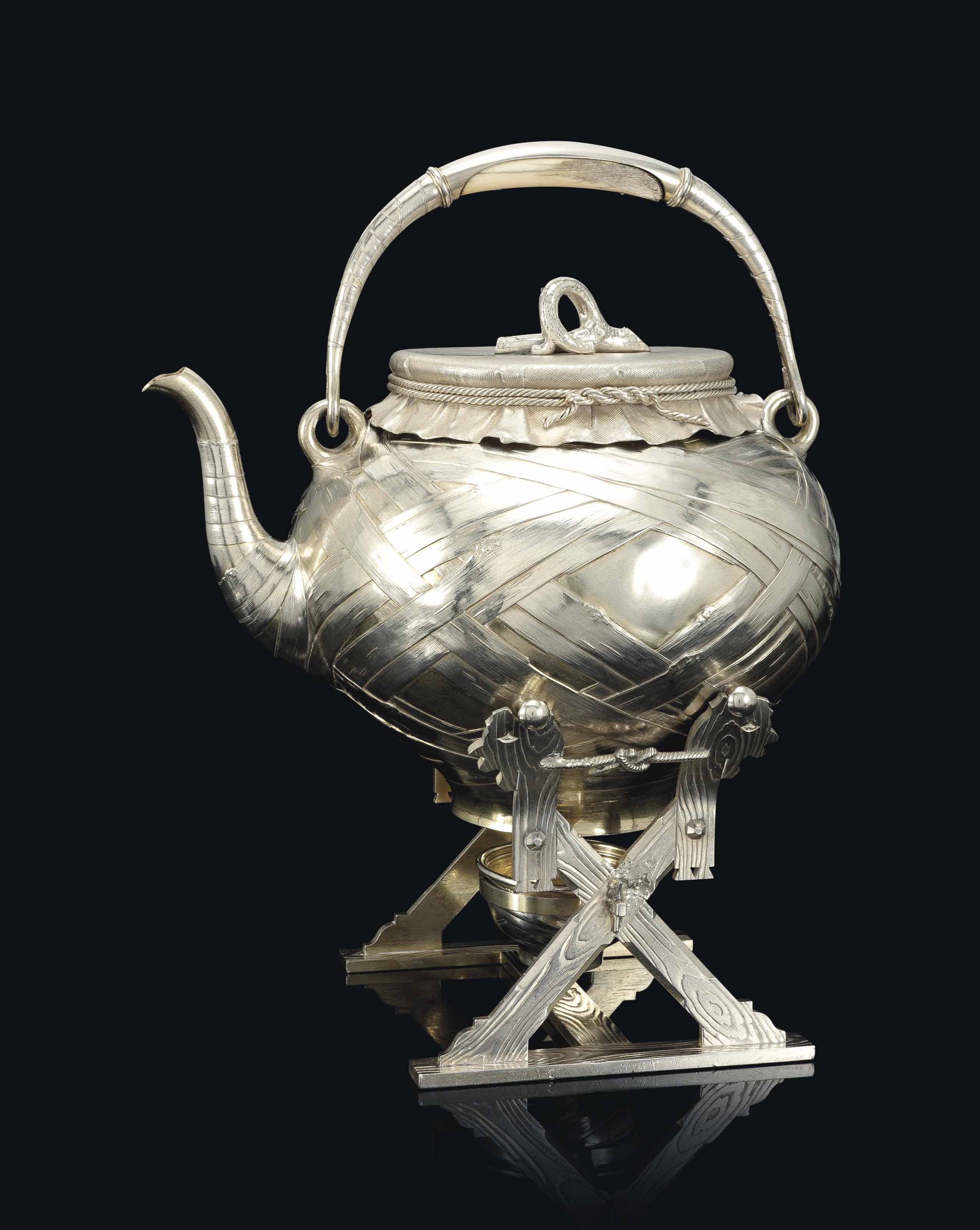 A SILVER TROMPE L'OEIL KETTLE-ON-STAND