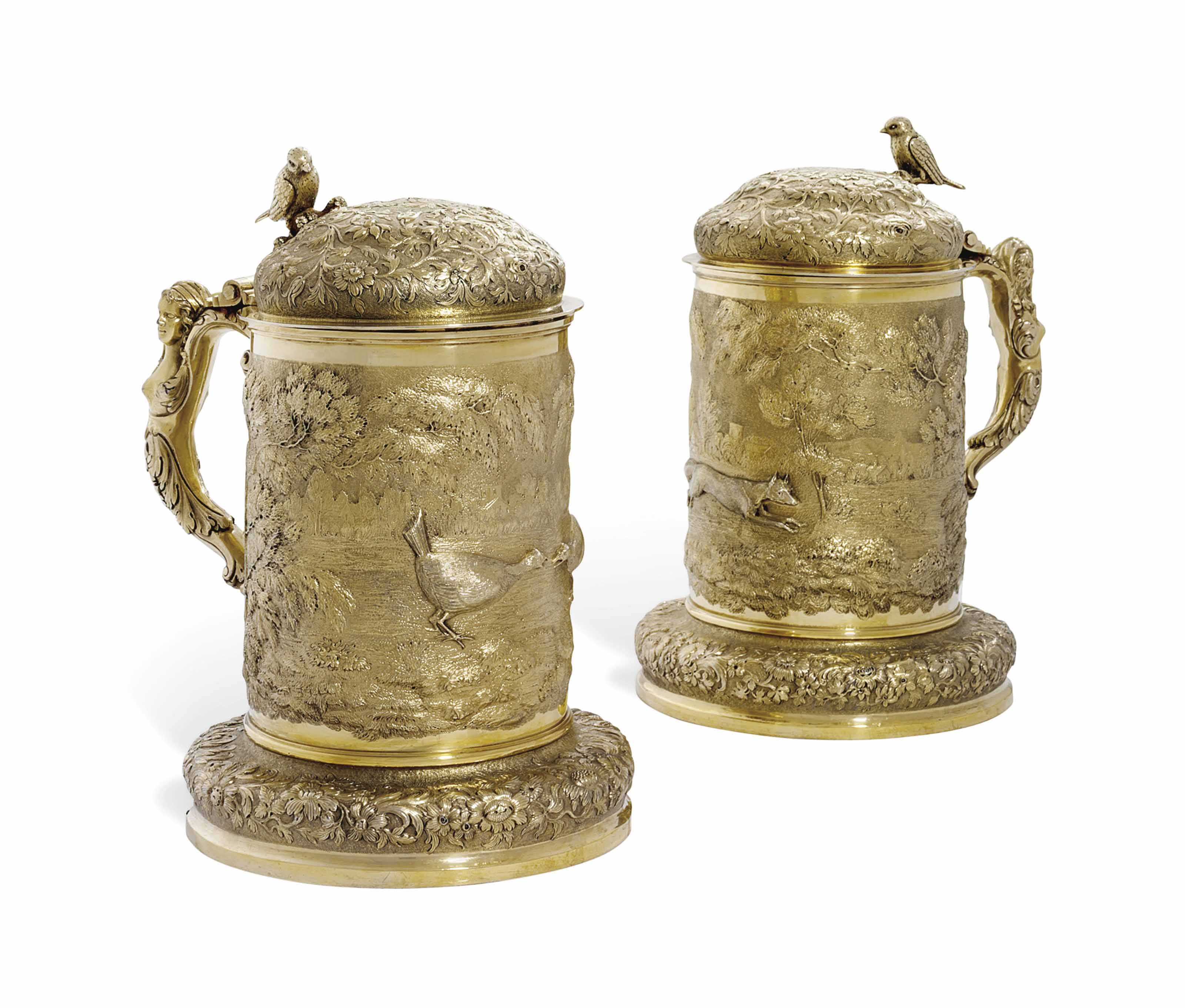 A PAIR OF GEORGE IV SILVER-GILT TANKARDS