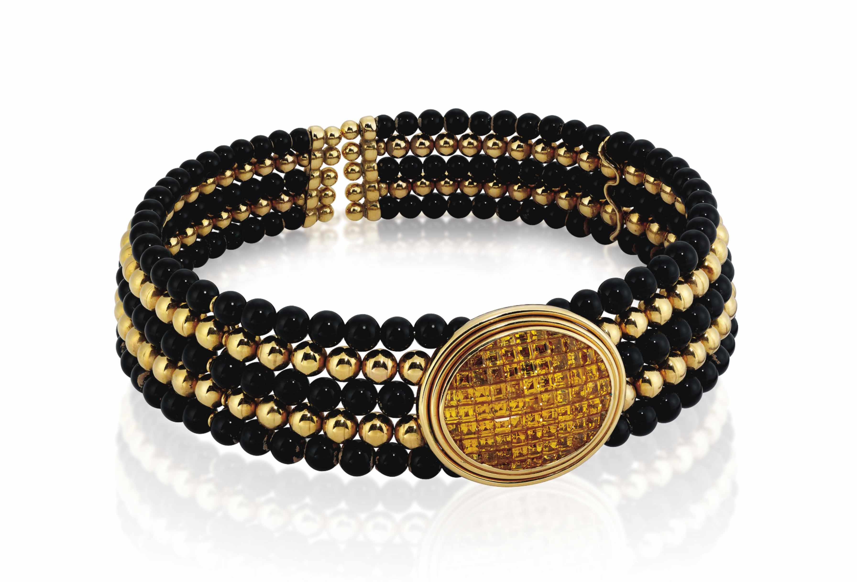 A YELLOW SAPPHIRE AND ONYX CHOKER, BY WILM