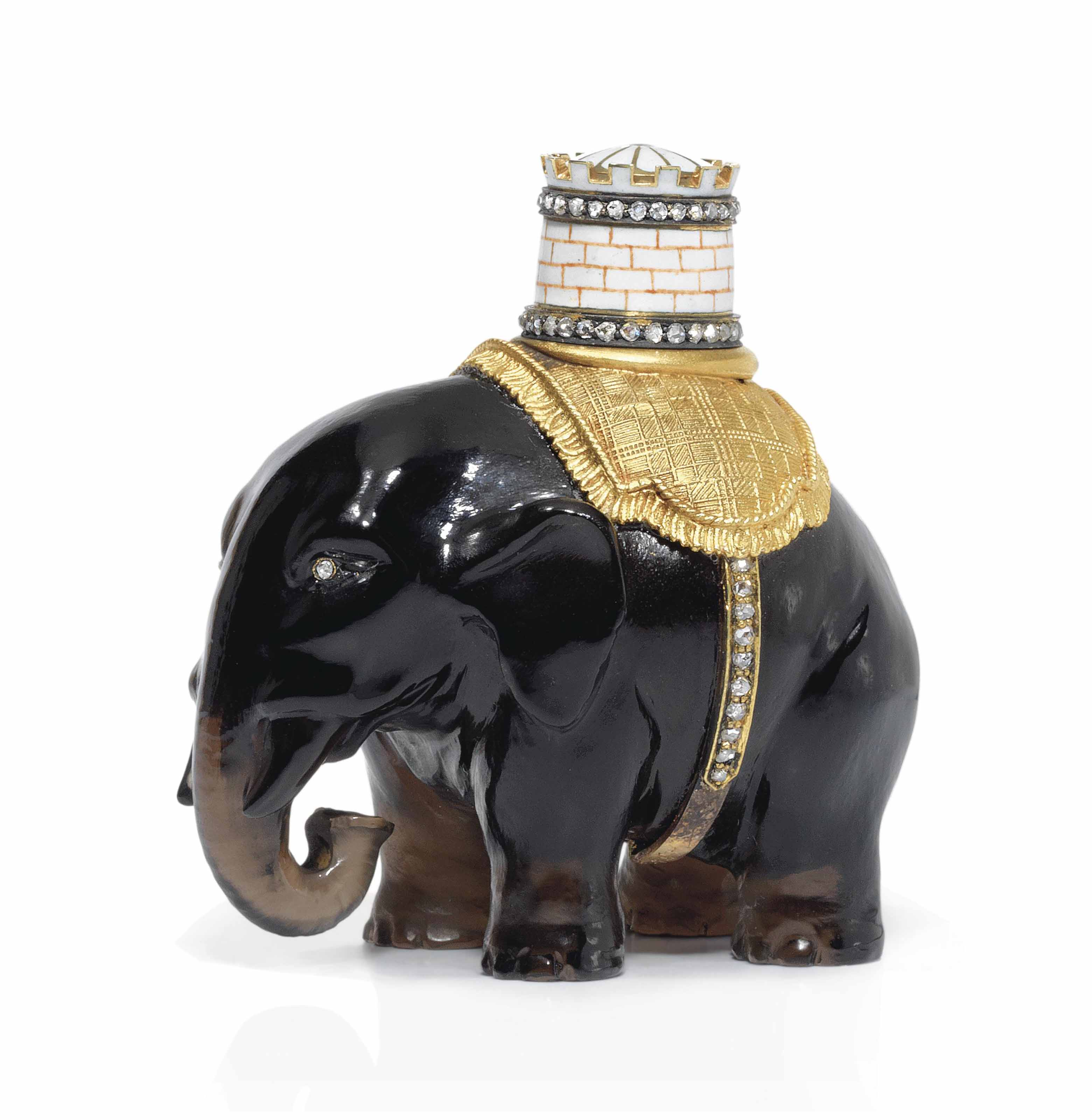 A JEWELLED GOLD-MOUNTED SMOKY QUARTZ MODEL OF AN ELEPHANT AND CASTLE
