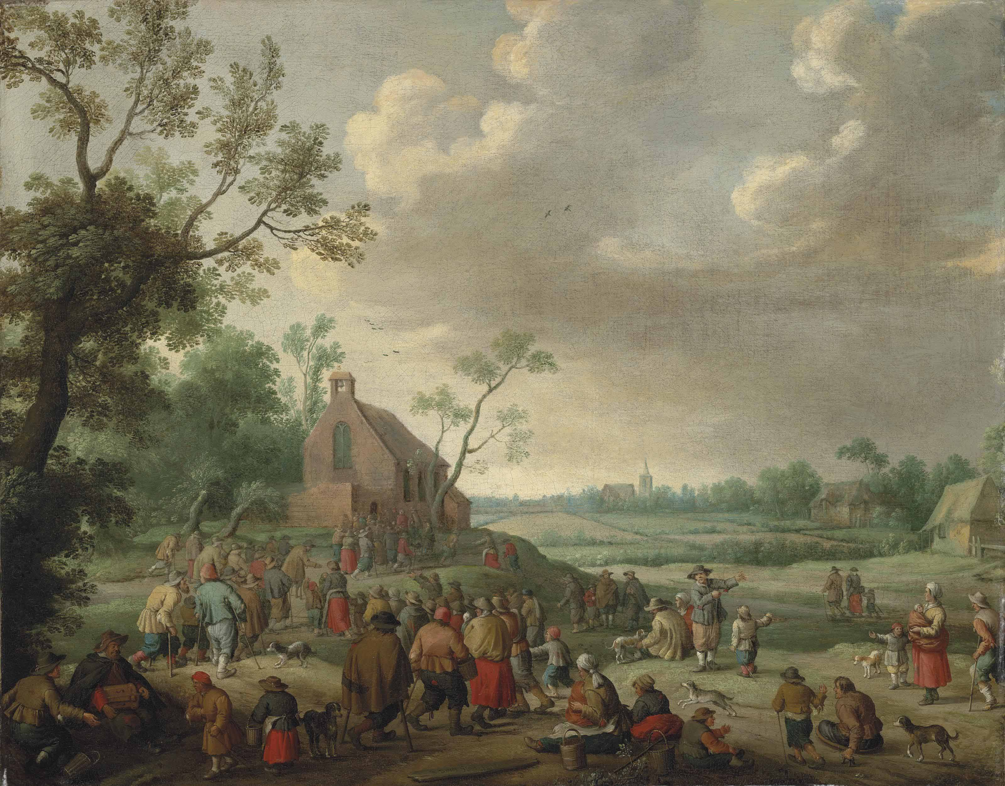A landscape with figures conversing and playing music, a church beyond