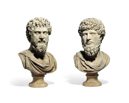 A PAIR OF CARVED MARBLE BUSTS
