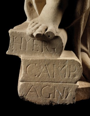 A CARVED STONE FEMALE ALLEGORI
