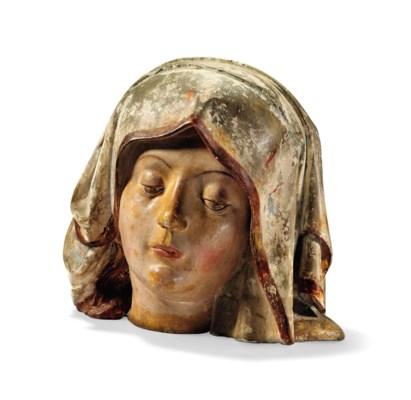 A POLYCHROME CARVED STONE HEAD