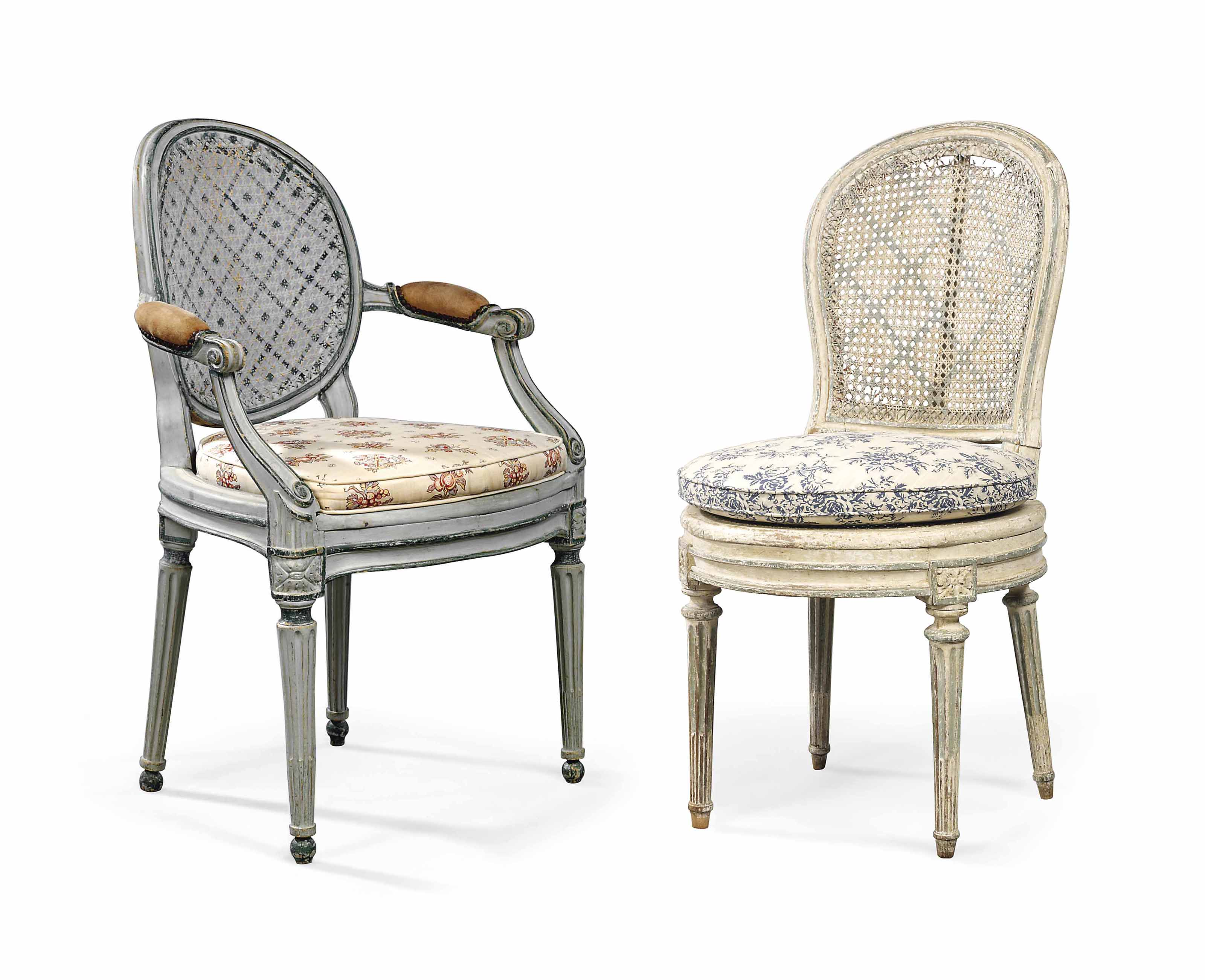 A LATE LOUIS XV GREEN-PAINTED FAUTEUIL