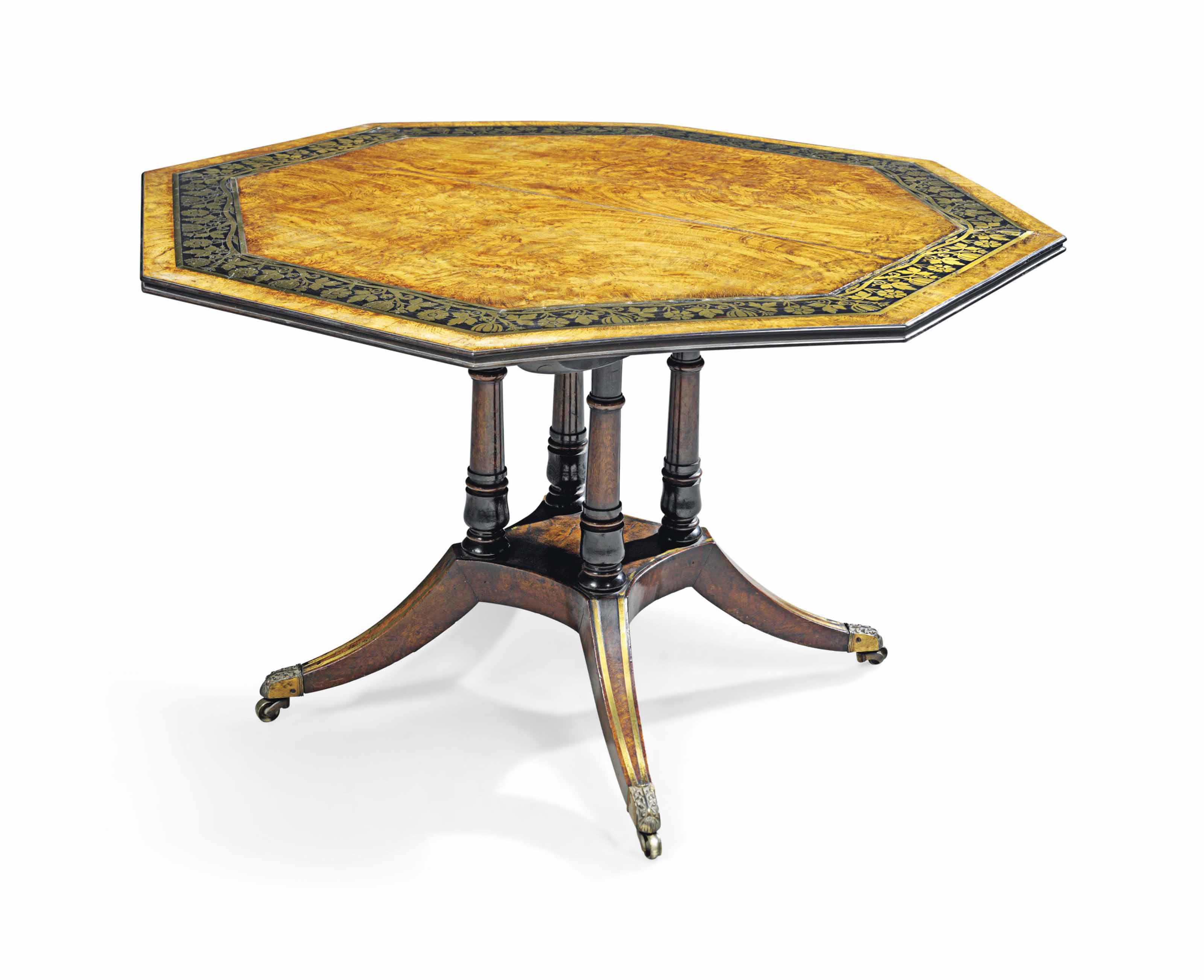 A REGENCY BRASS AND EBONY-INLAID FIGURED OAK OCTAGONAL CENTRE TABLE