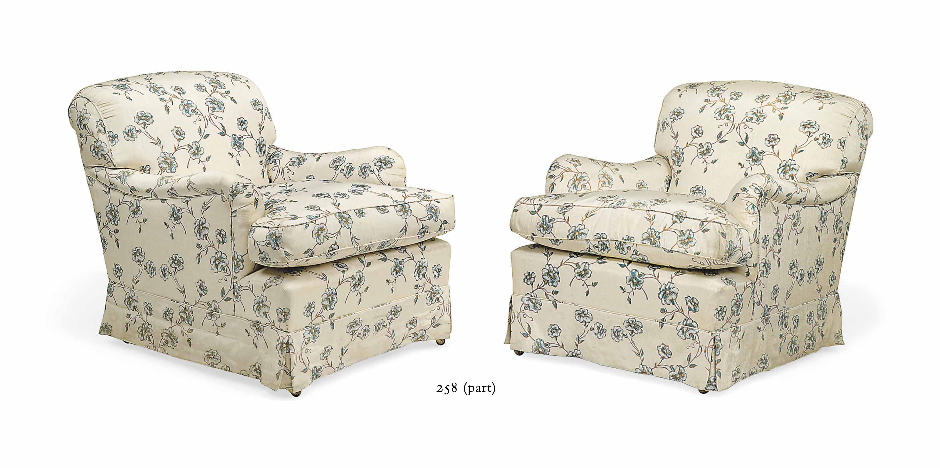 A PAIR OF 'HOWARD' EASY ARMCHAIRS