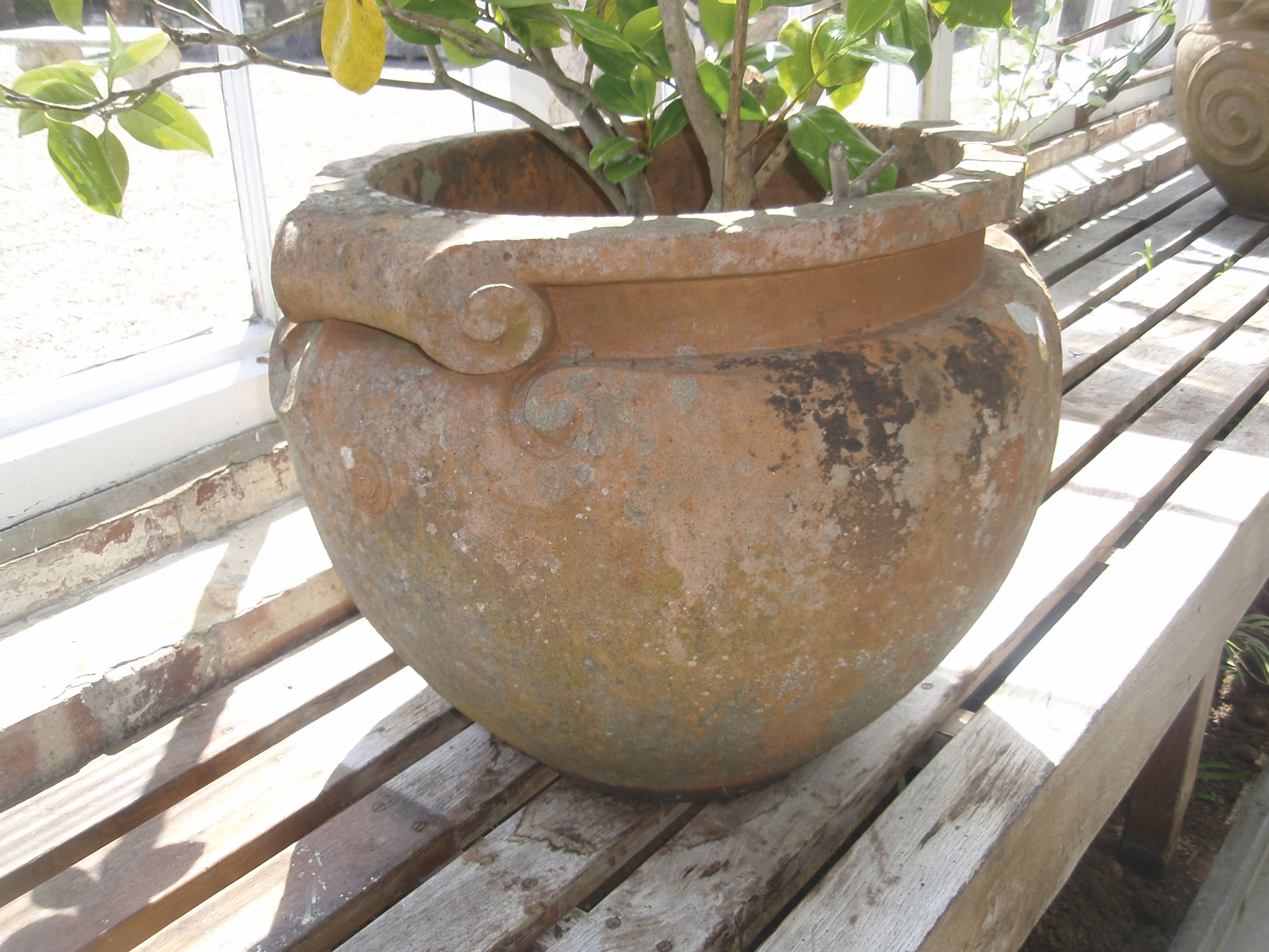 A PAIR OF COMPTON POTTERY TERRACOTTA 'SCROLL' POTS