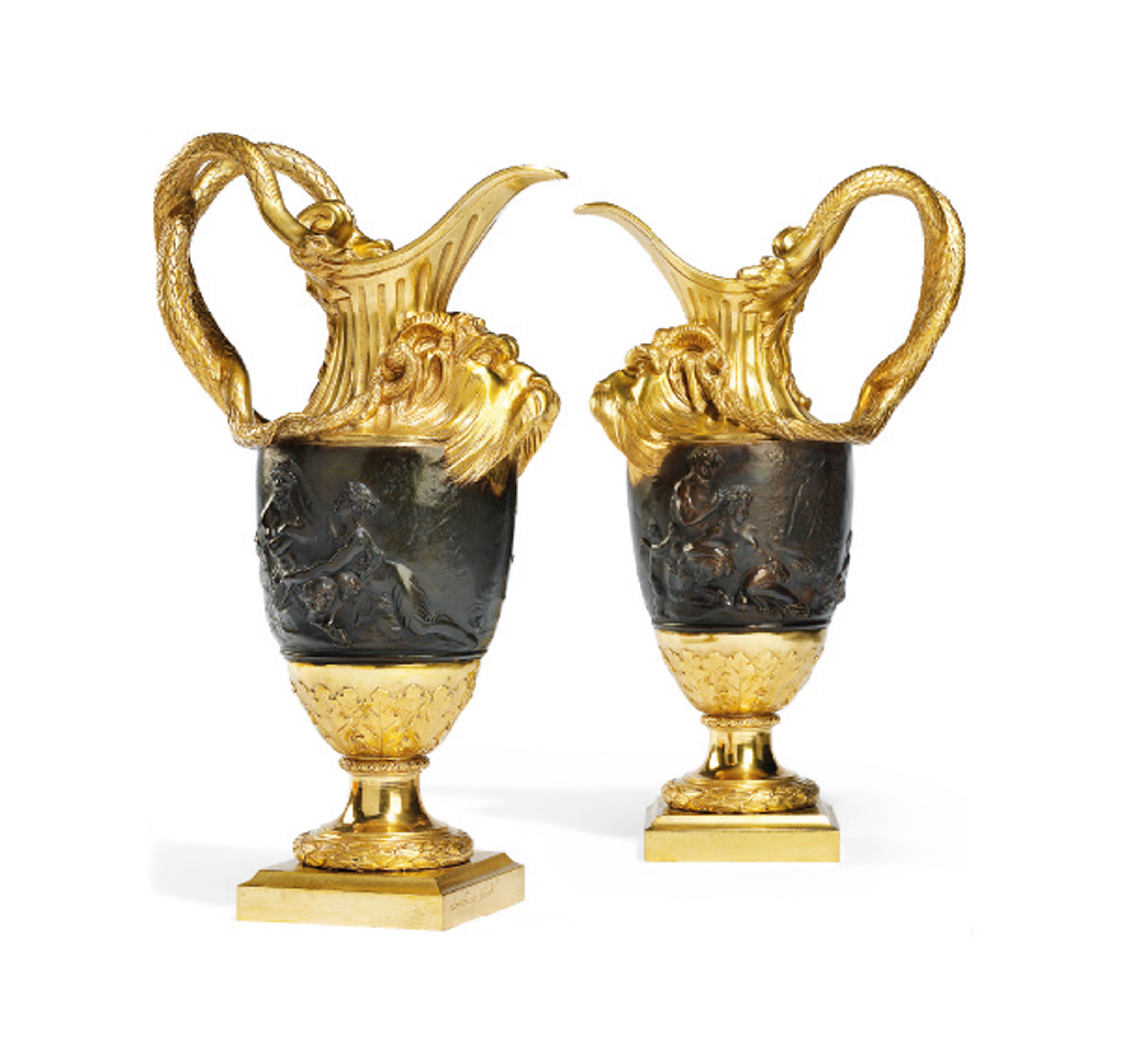 A PAIR OF FRENCH GILT AND PATINATED BRONZE EWERS