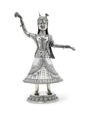 AN INDIAN SILVERED METAL FIGUR