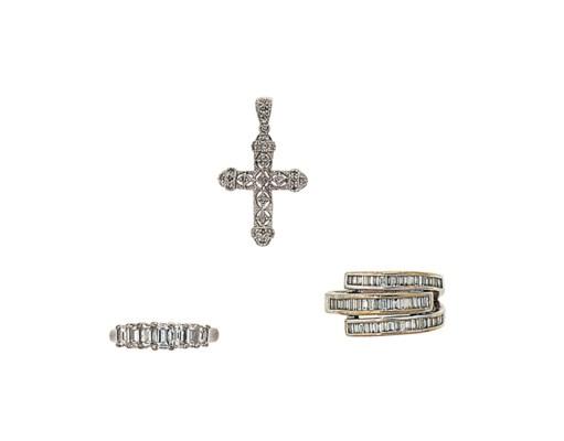 A diamond-set cross and two di