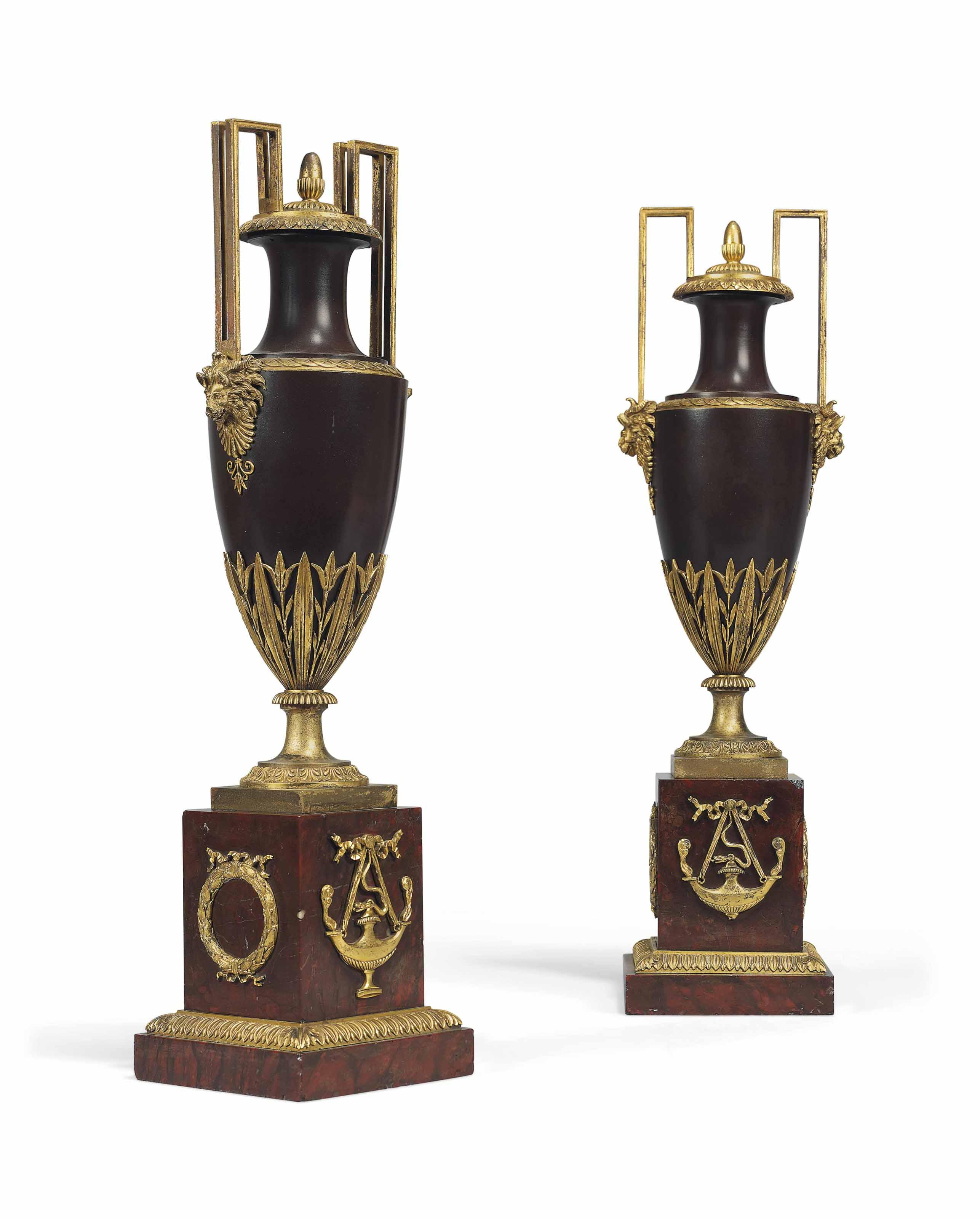 A PAIR OF DIRECTOIRE ORMOLU-MOUNTED PATINATED BRONZE VASES AND COVERS