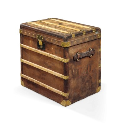 A SMALL TRUNK IN BROWN CANVAS