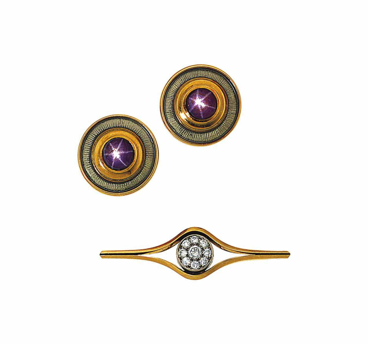 A pair of star ruby earrings and a diamond brooch, by De Vroomen