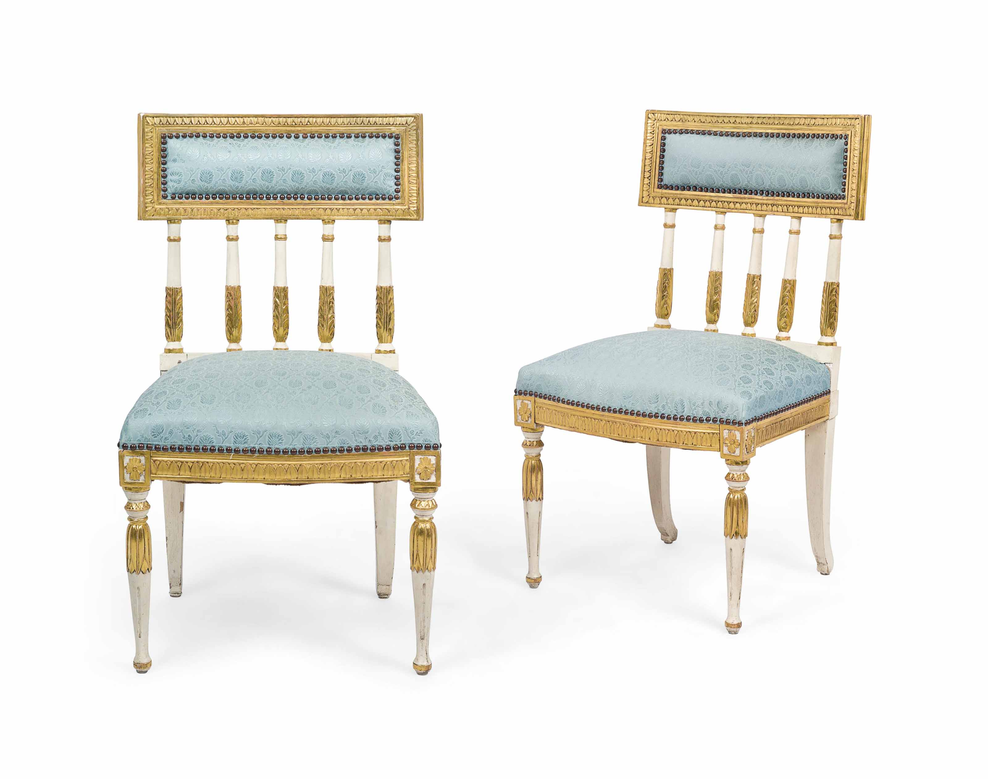 A PAIR OF SWEDISH PARCEL-GILT AND CREAM-PAINTED SIDE CHAIRS