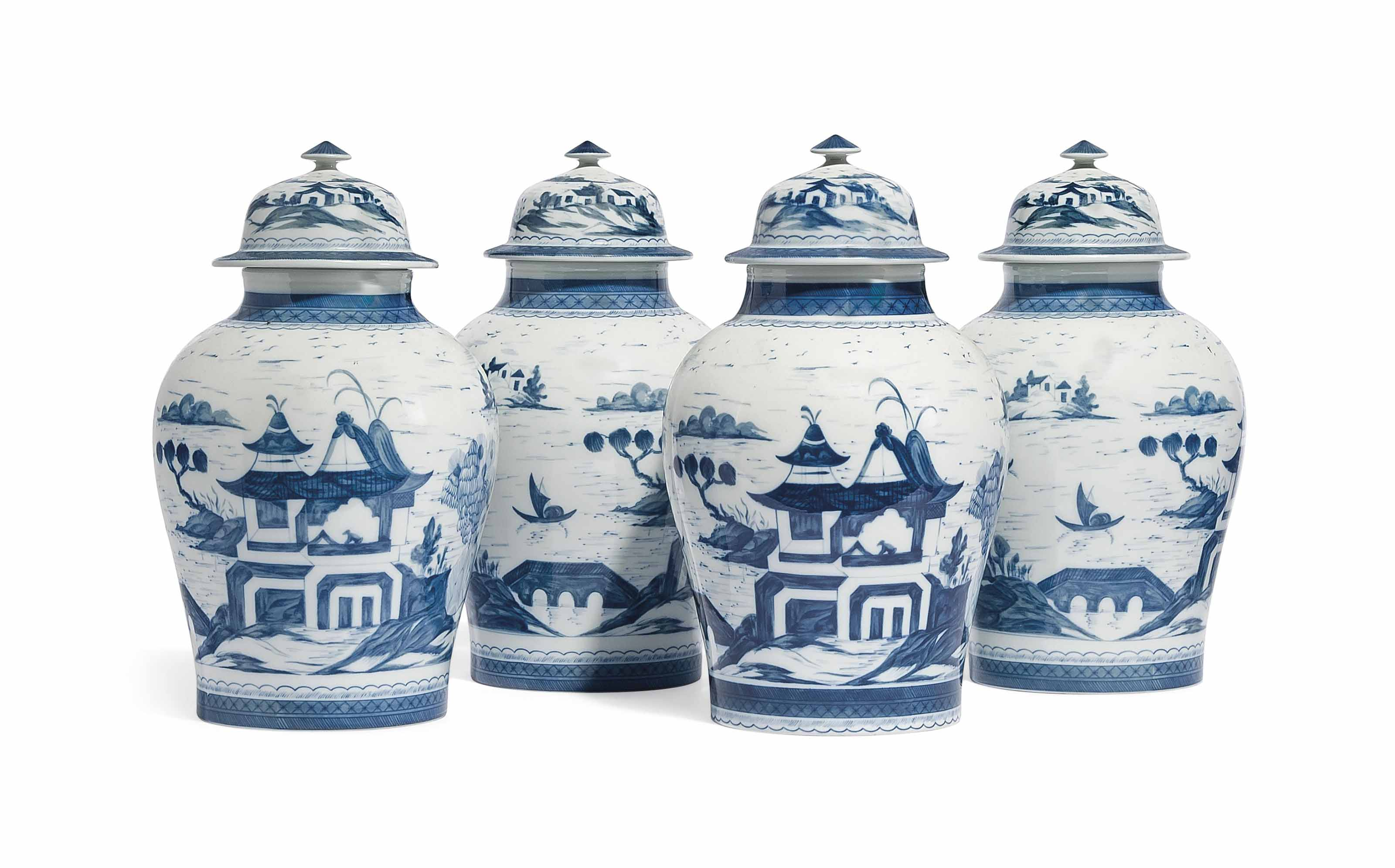 A SET OF FOUR CHINESE-STYLE BLUE AND WHITE BALUSTER JARS AND COVERS