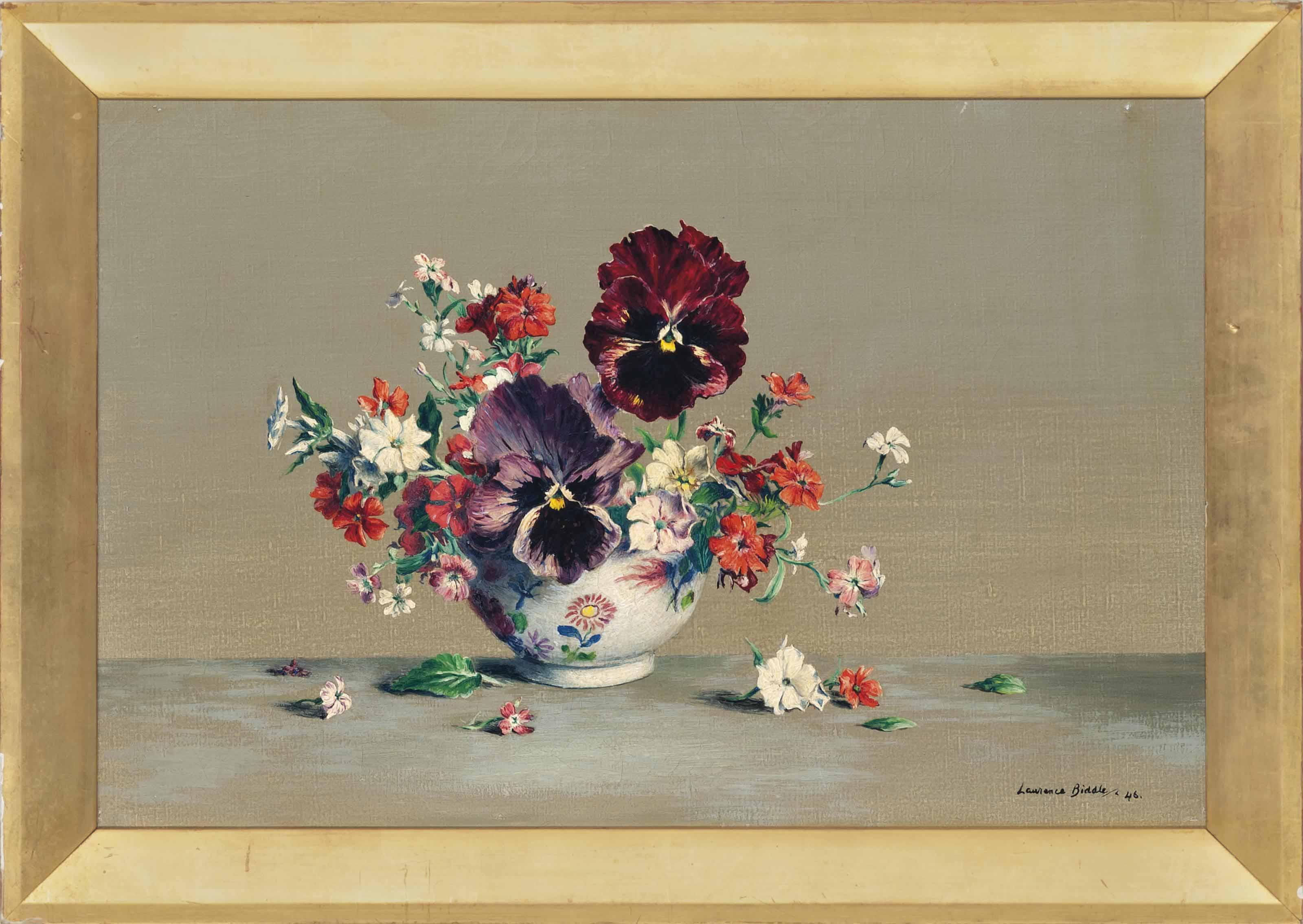 Pansies, primroses and geraniums in a vase