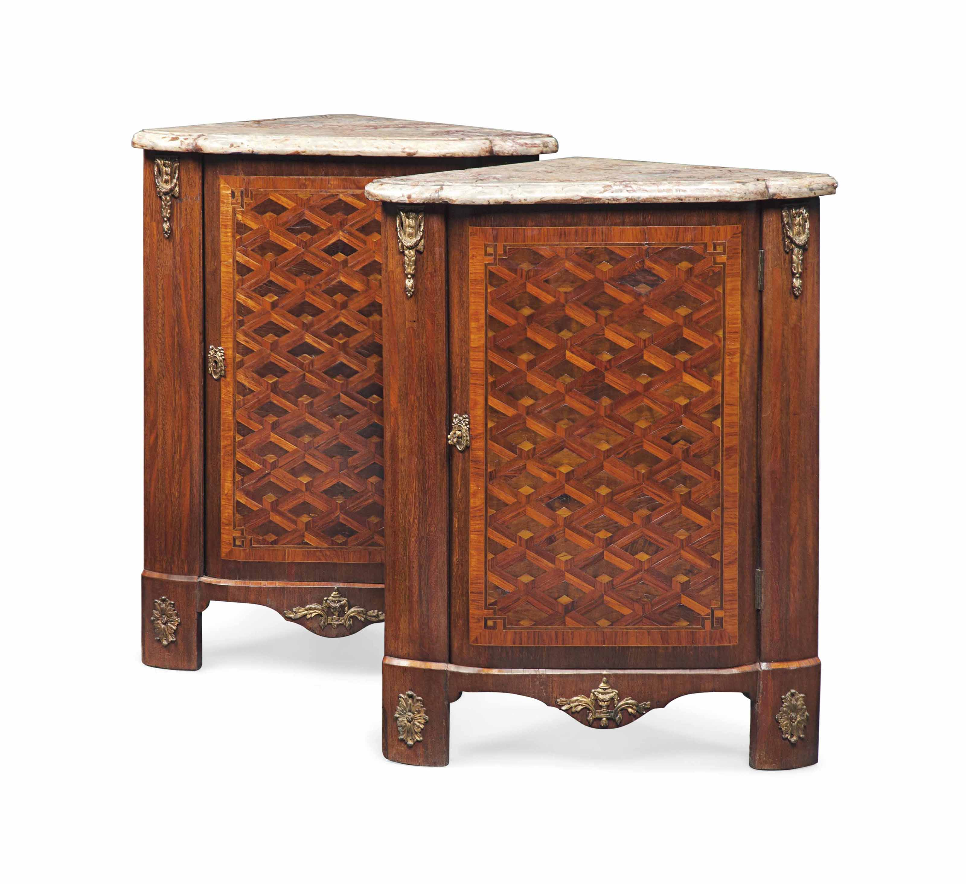 A PAIR OF LATE LOUIS XV ORMOLU-MOUNTED AMARANTH, KINGWOOD AND TULIPWOOD PARQUETRY ENCOIGNEURES