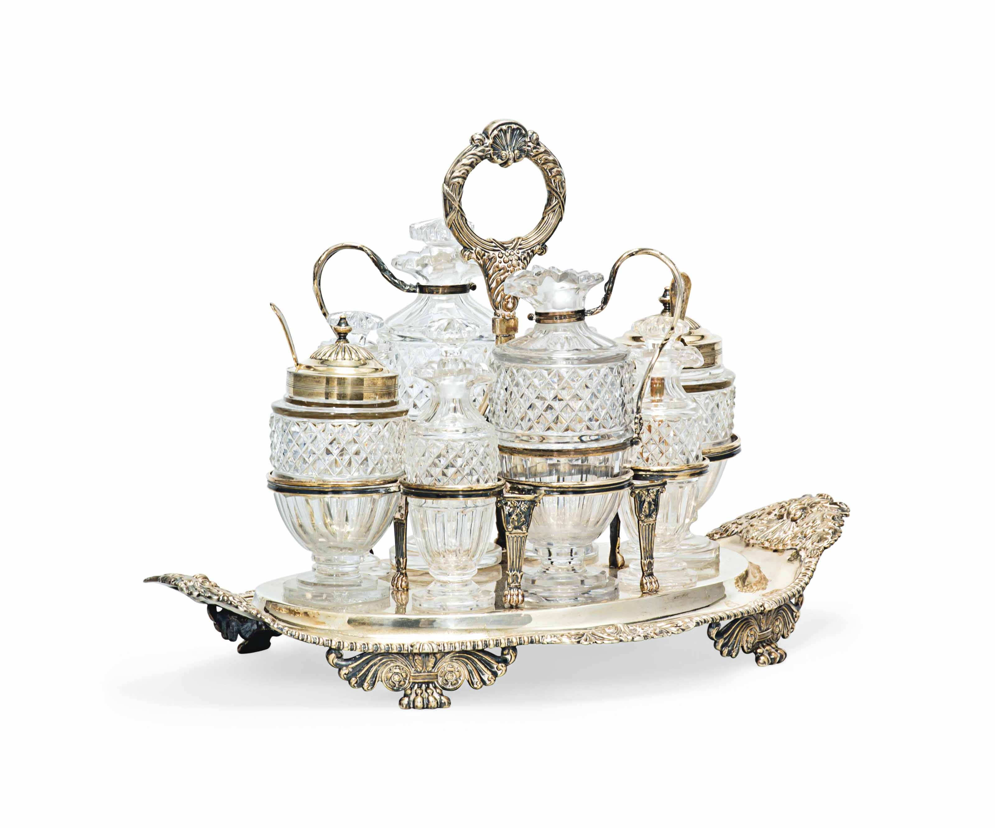 A GEORGE III SILVER EIGHT BOTTLE CRUET