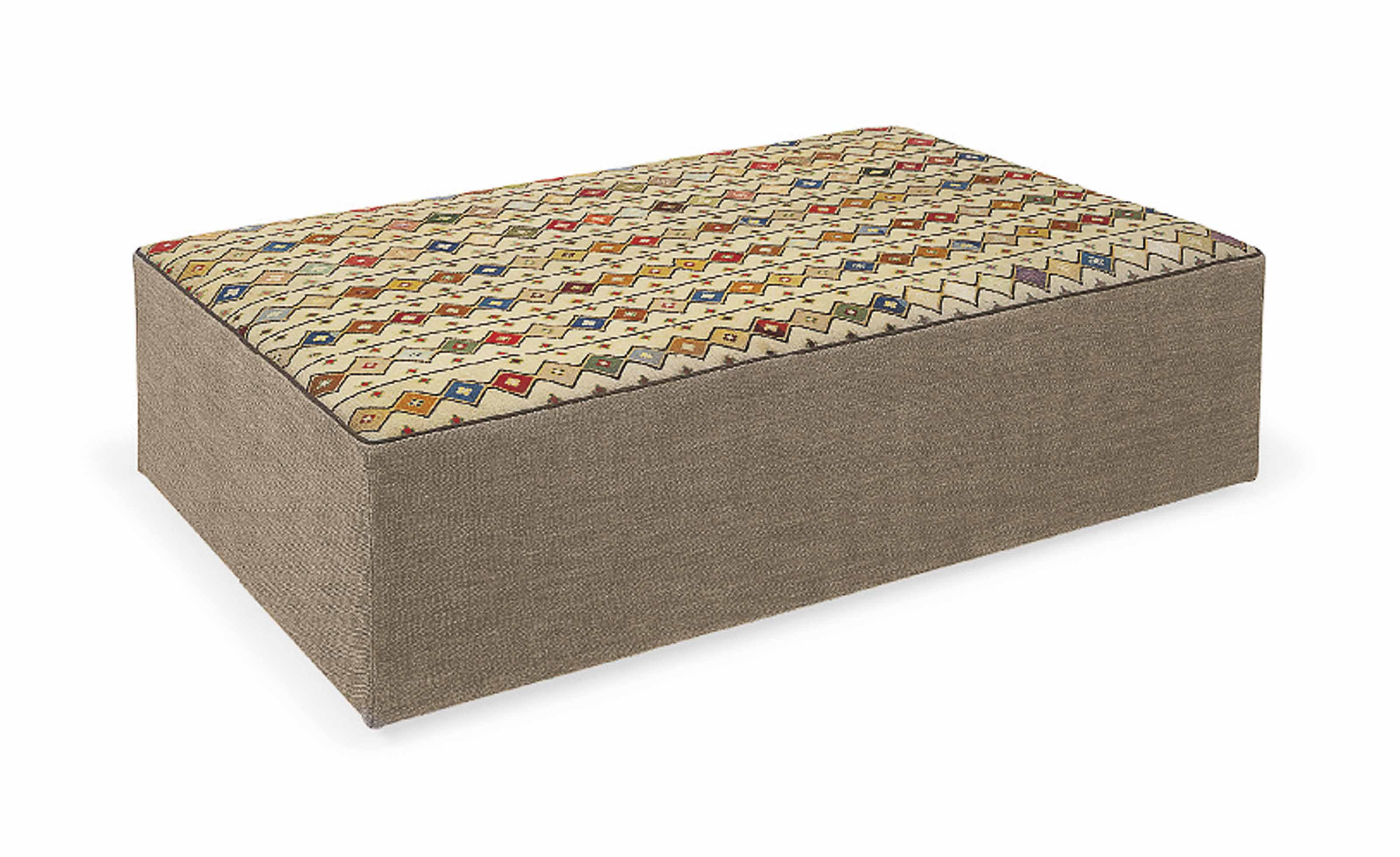 A GEOMETRIC NEEDLEWORK-COVERED OTTOMAN