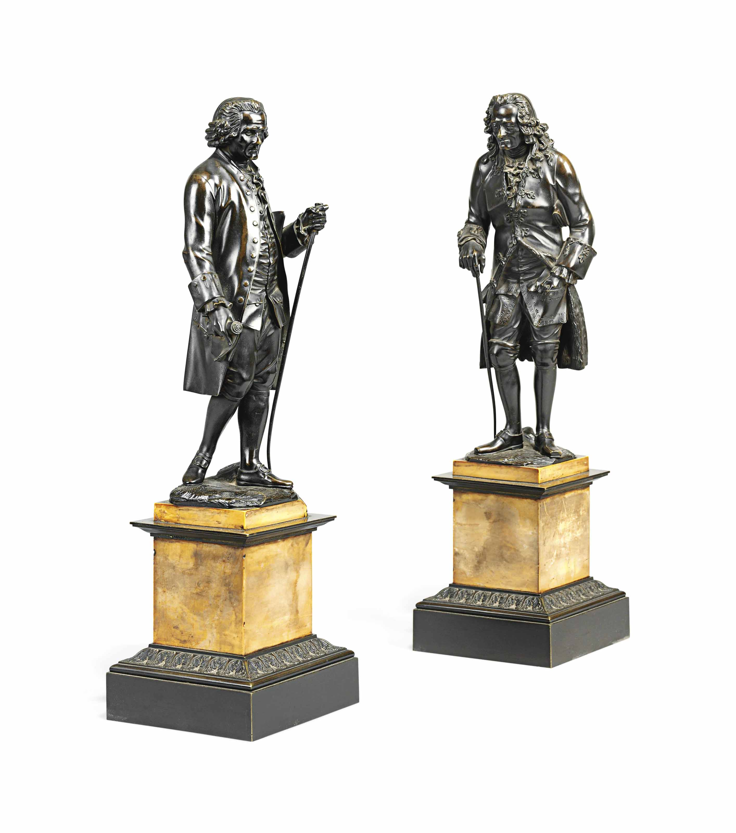 A PAIR OF CHARLES X BRONZE FIGURES OF VOLTAIRE AND ROUSSEAU