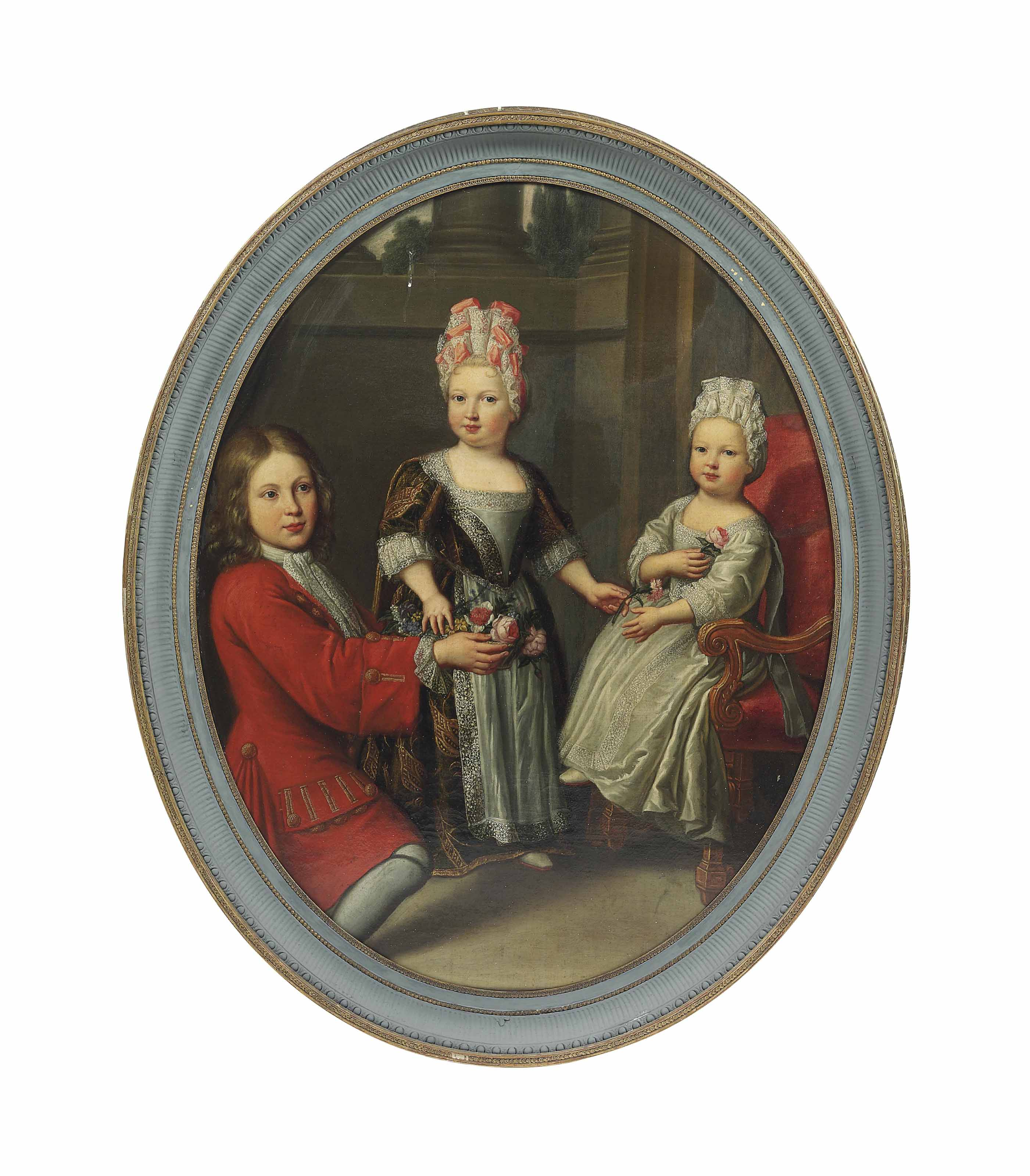 Portrait of a young man and two girls in an interior