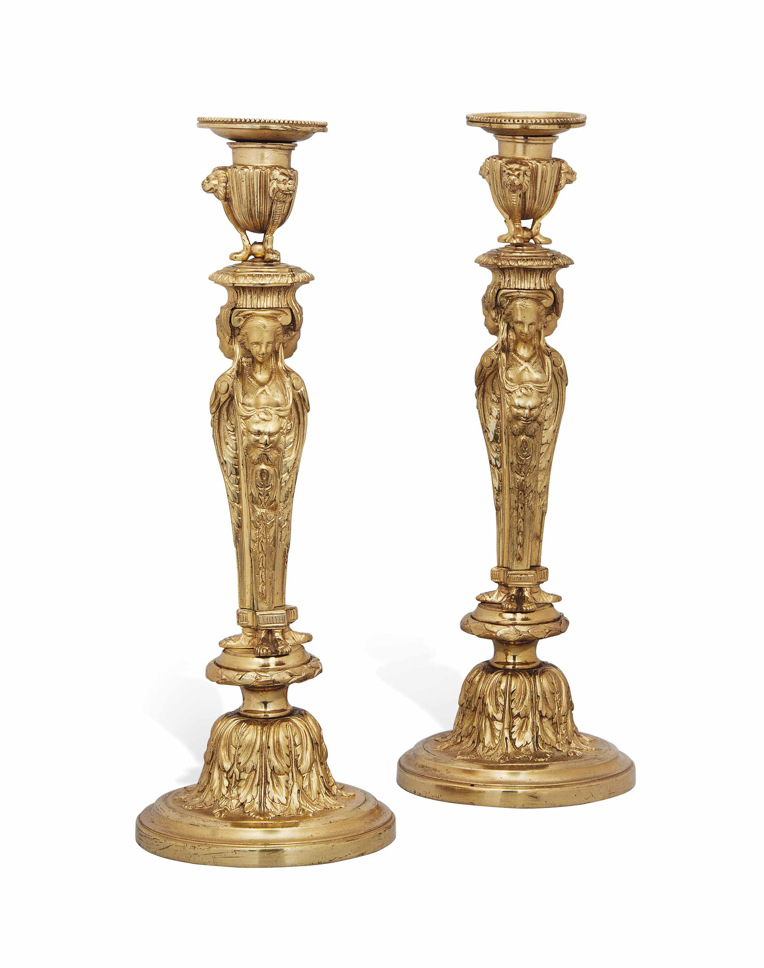 A PAIR OF FRENCH GILT-BRONZE CANDLESTICKS