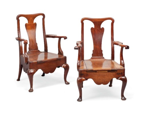 A PAIR OF MAHOGANY COMMODE ARM