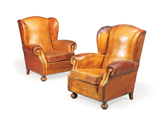 A PAIR OF LEATHER CLUB CHAIRS