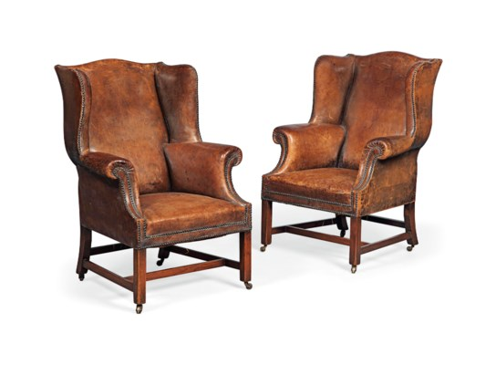 A PAIR OF OAK WING ARMCHAIRS