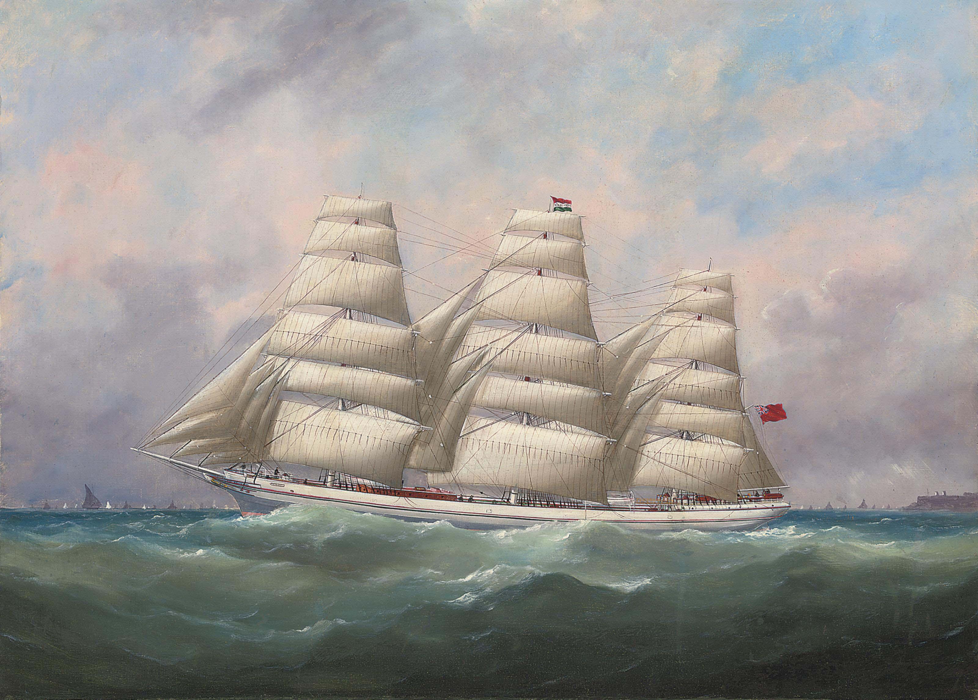 The three-master Hahnemann in full sail off a headland