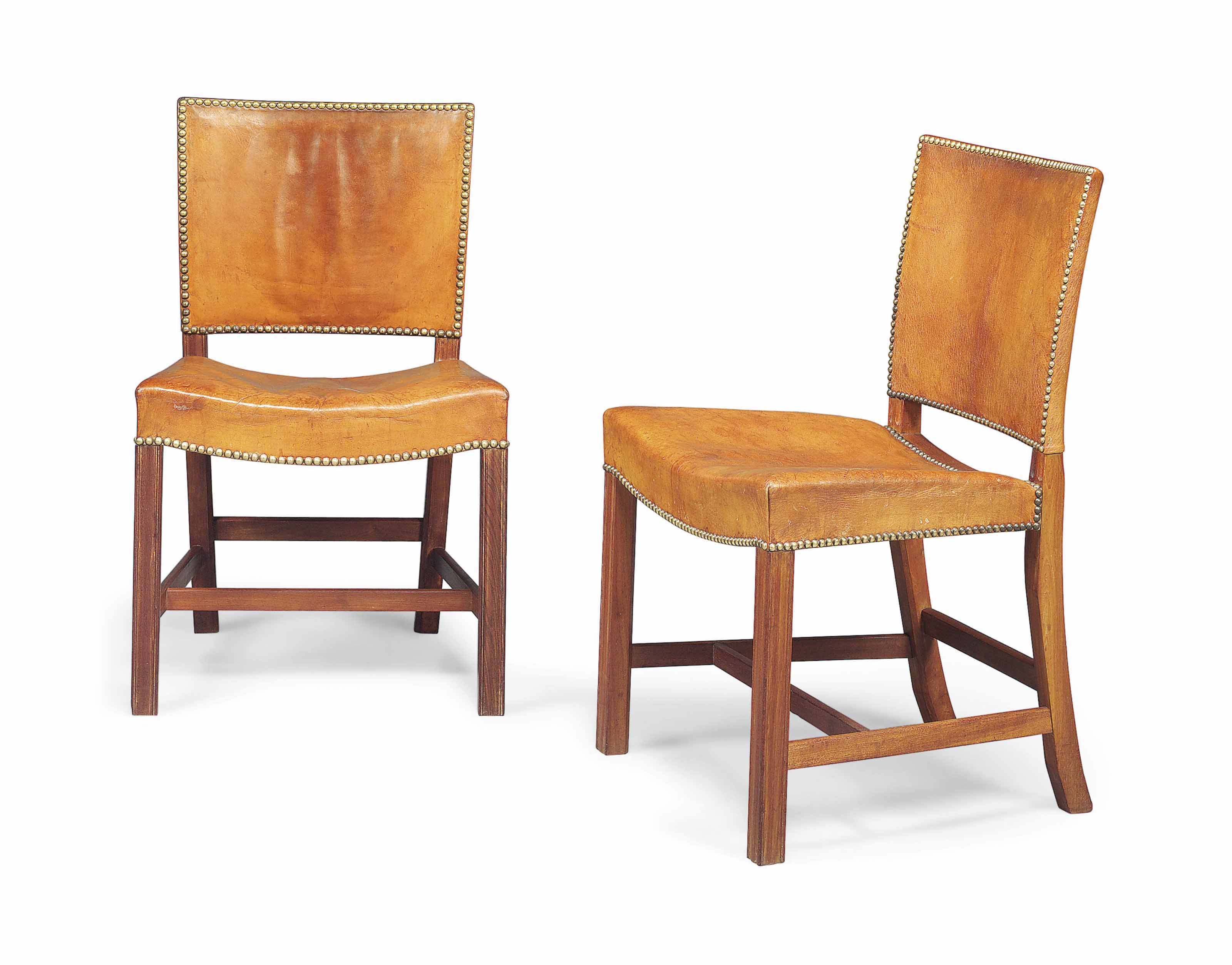A PAIR OF KAARE KLINT (1888-1954) CUBAN MAHOGANY AND LEATHER UPHOLSTERED 'RED CHAIRS'