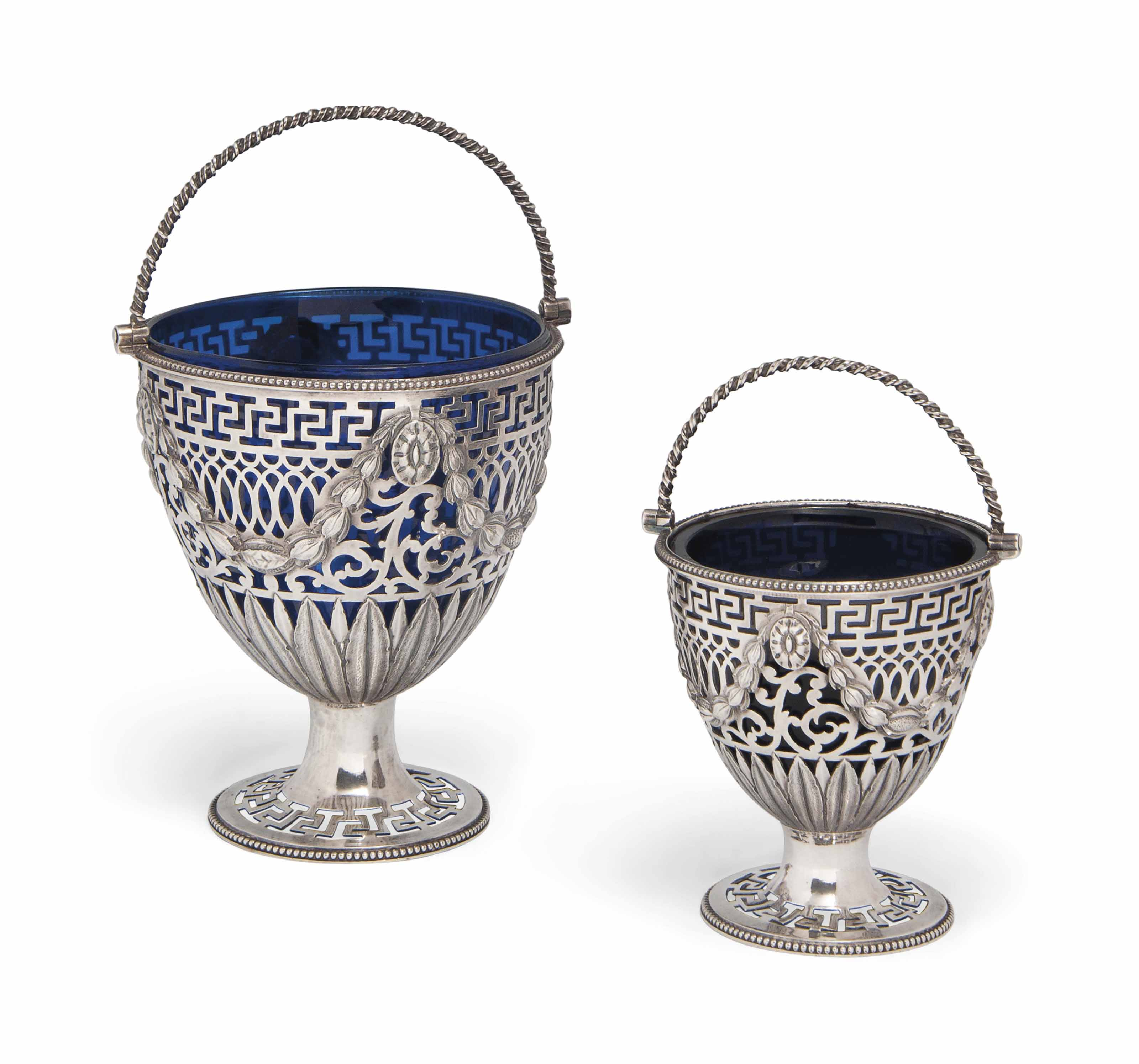A MATCHED GRADUATED PAIR OF GEORGE III SILVER SWING-HANDLED SUGAR BASKETS