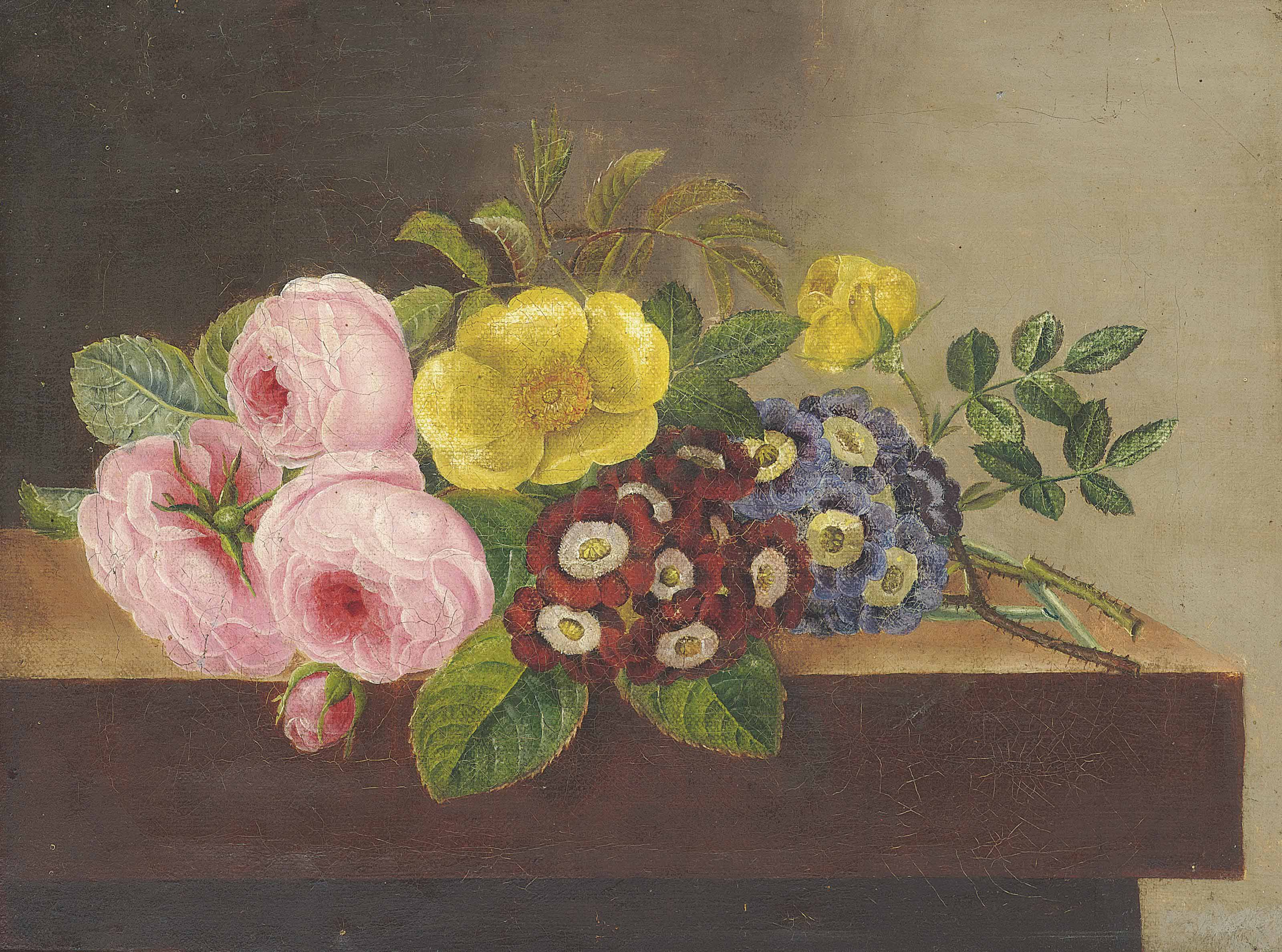 Pink and yellow roses and primroses on a wooden ledge
