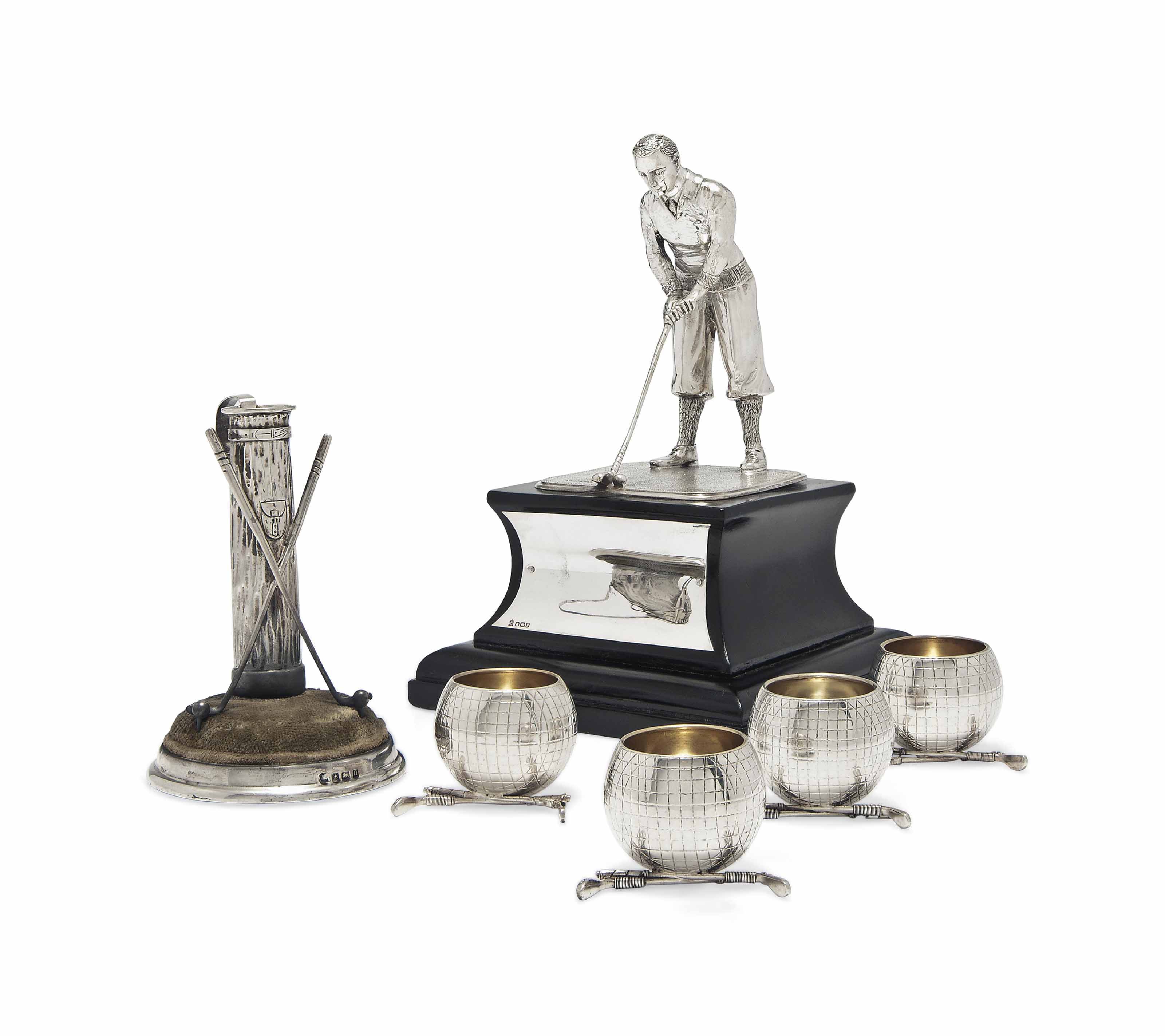 GOLFING INTEREST:- A SILVER TROPHY IN THE FORM OF A GOLFER PUTTING