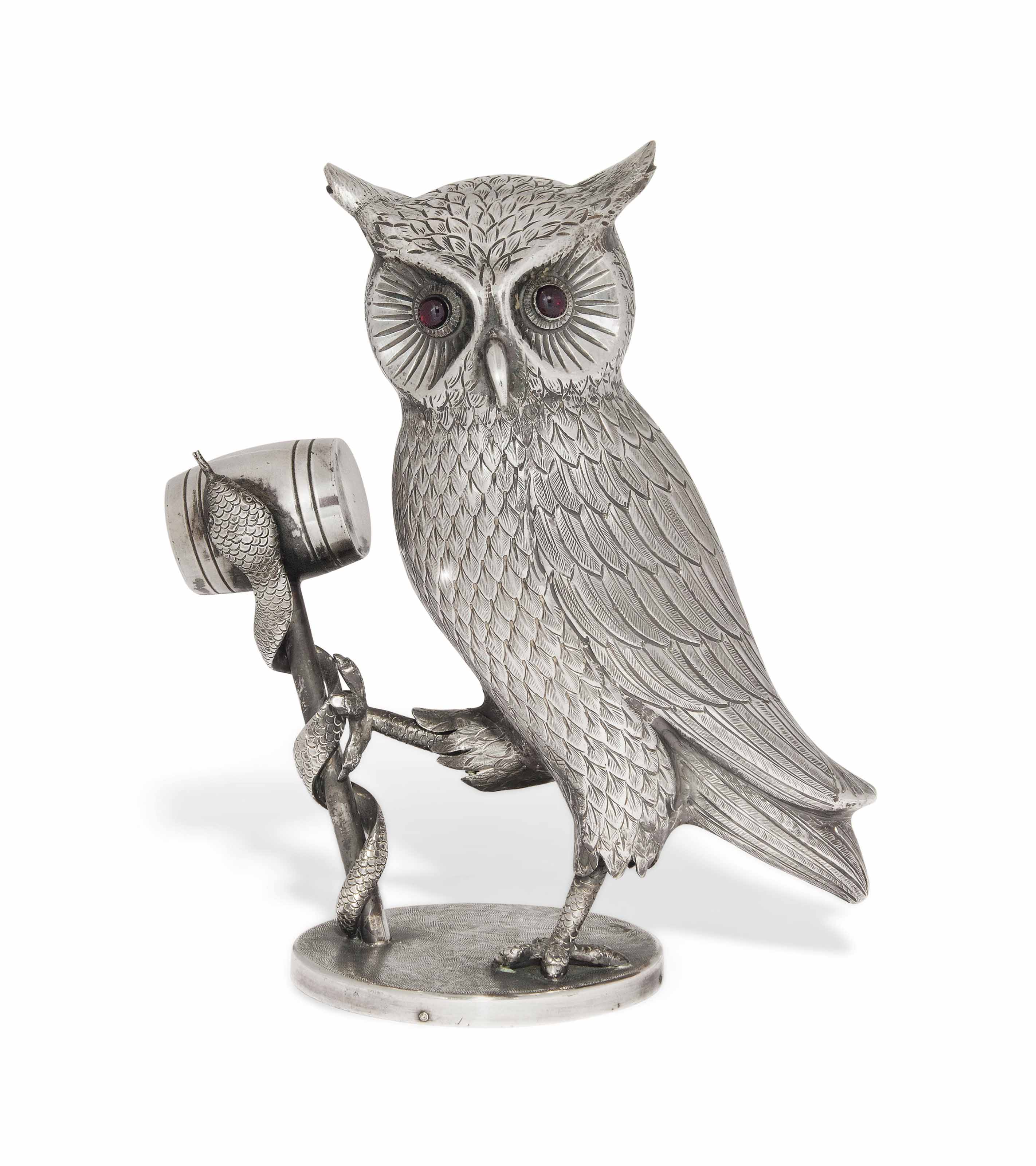 A MODERN SILVER STATUE OF AN OWL SUPPORTING A SERPENT WRAPPED AROUND A MALLET
