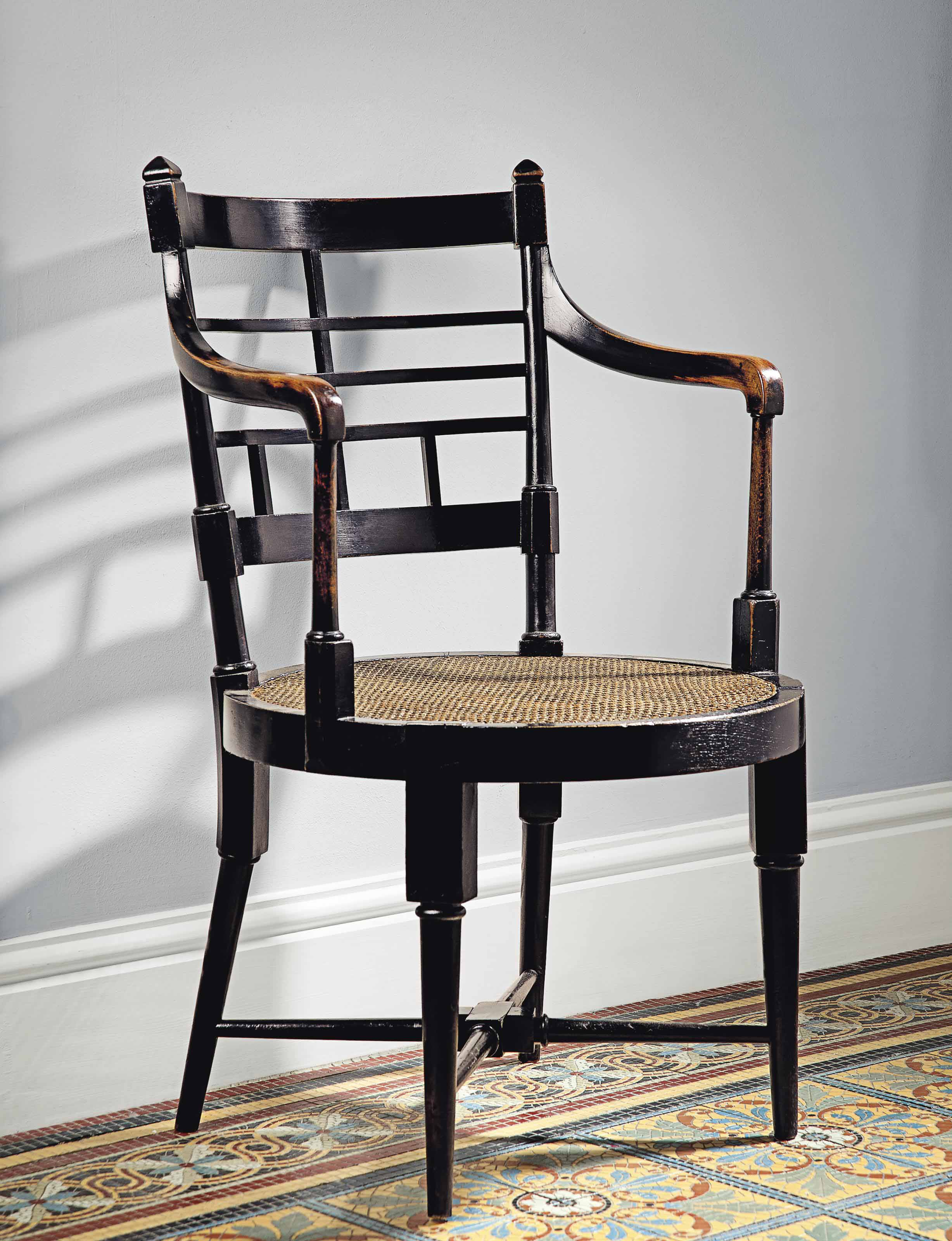 A PAIR OF EBONISED BEECH ANGLO-JAPANESE OPEN ARMCHAIRS, AFTER E.W. GODWIN (1833-1886)