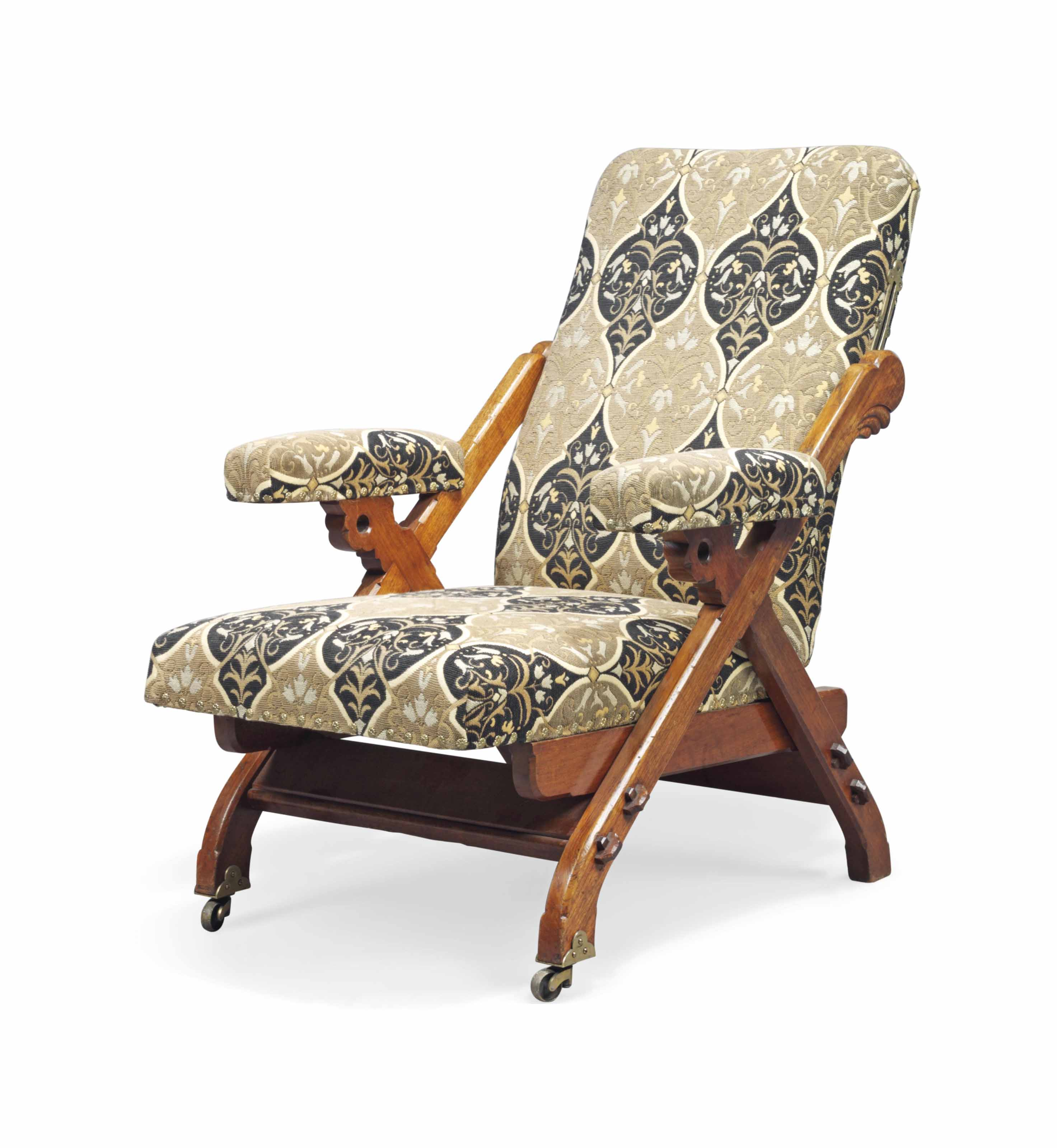 A CHARLES BEVAN (FL.1865-1882) WALNUT AND UPHOLSTERED RECLINING ARMCHAIR