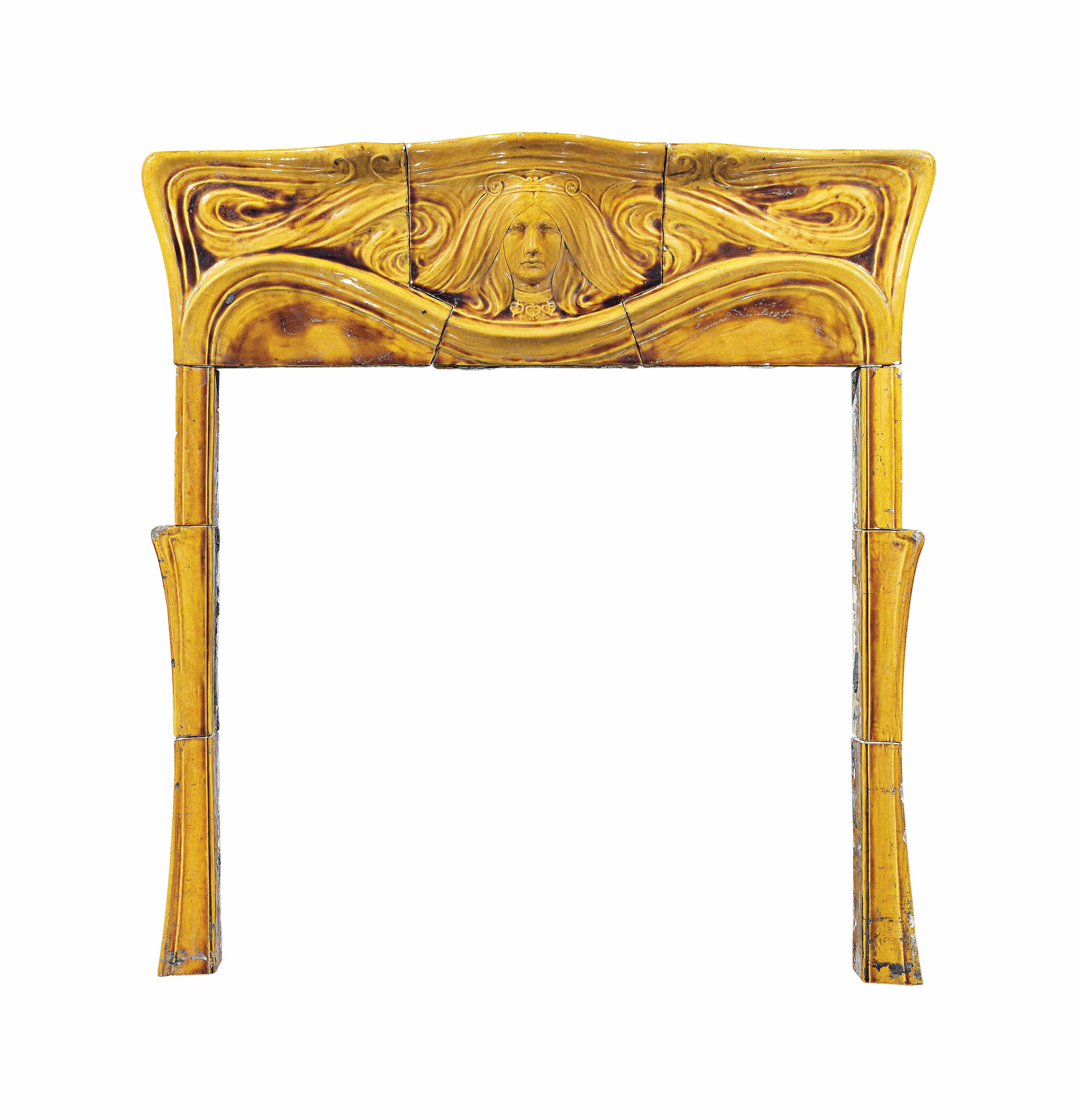 AN ART NOUVEAU GLAZED POTTERY FIRE SURROUND, ATTRIBUTED TO BURMANTOFTS (1842-1957) TO A DESIGN BY WILLIAM J. NEATBY (1860-1910)