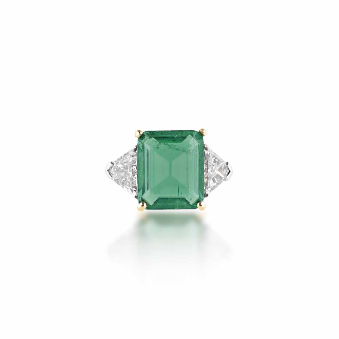 AN EMERALD AND DIAMOND RING, BY CUSI
