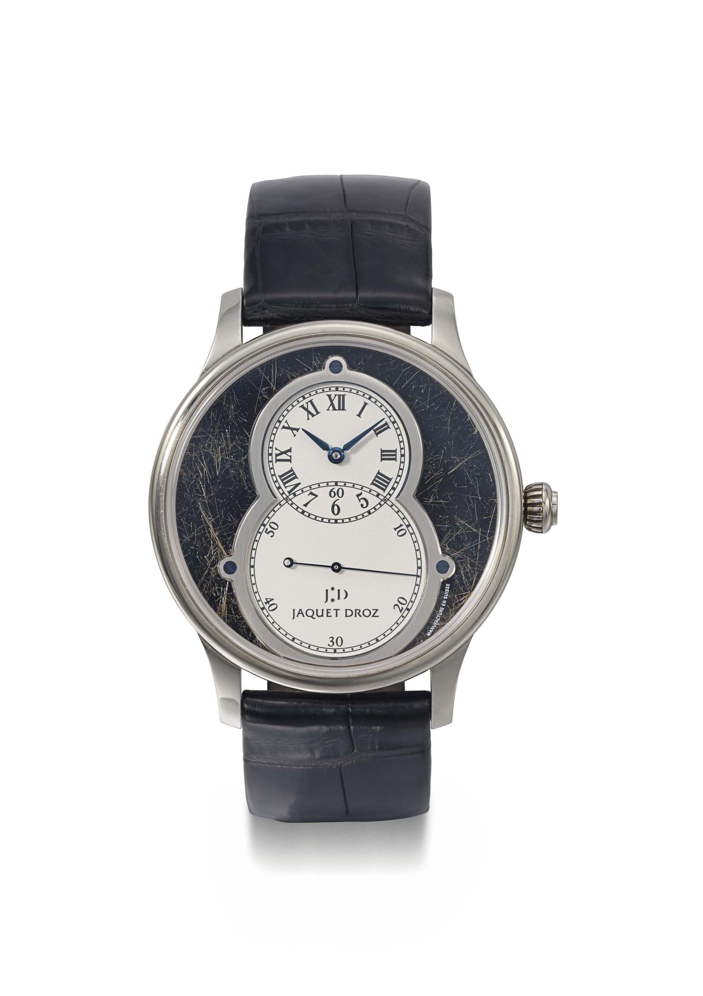 Jaquet Droz. A fine, rare and large 18K white gold limited edition oversized automatic wristwatch with off-centered time display, black textured dial, original Certificate and box