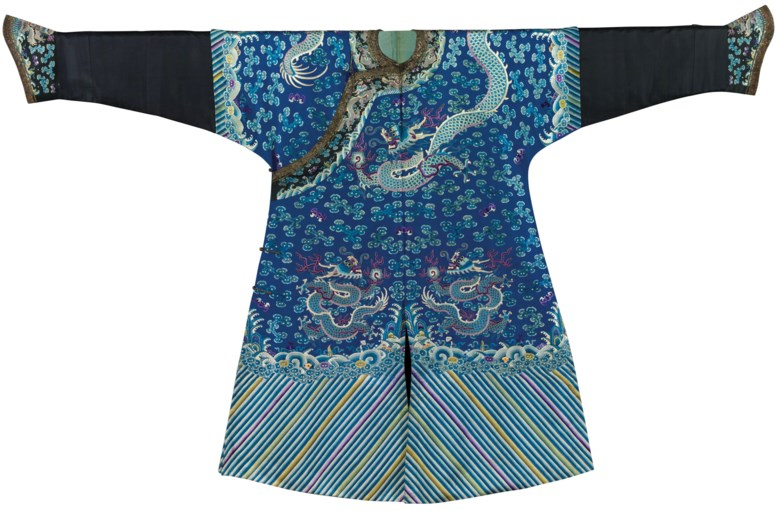 An extremely rare embroidered blue silk dragon robe for a seventh to ninth rank civil official in the Imperial Board of State Music, jifu, early Guangxu period, circa 1885. 53¼  in (135.3  cm) long x 90½  in (229.9  cm) across. Sold for HK$750,000 on 29 May 2013  at Christie's in Hong Kong