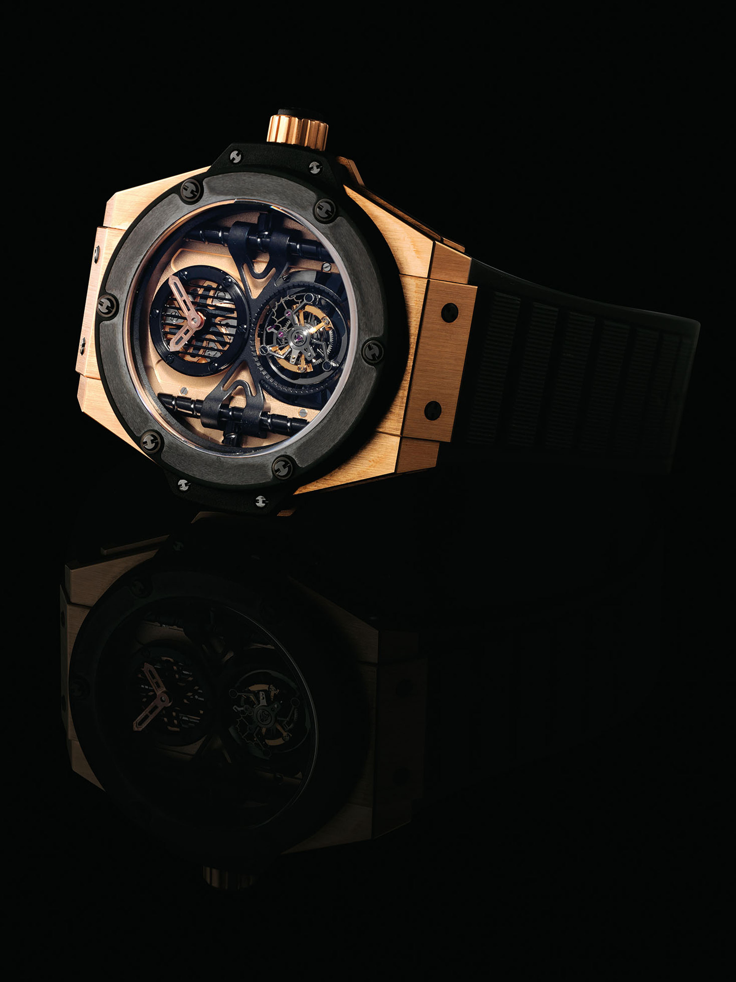 HUBLOT. AN OVERSIZED AND RARE 18K PINK GOLD AND TITANIUM LIMITED EDITION SEMI-SKELETONISED TOURBILLON WRISTWATCH
