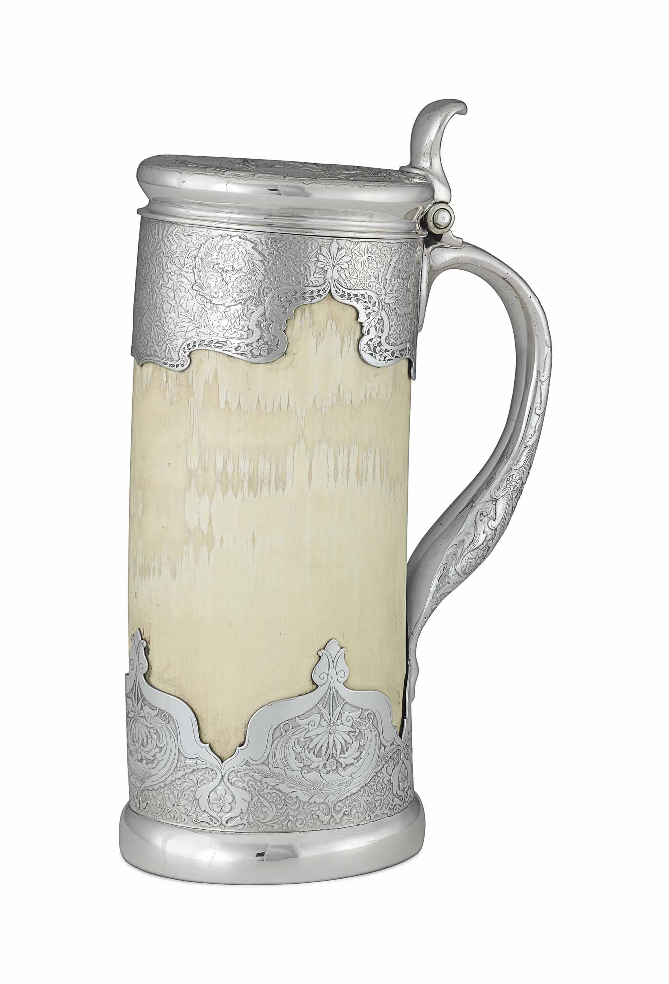A SILVER AND IVORY TANKARD**