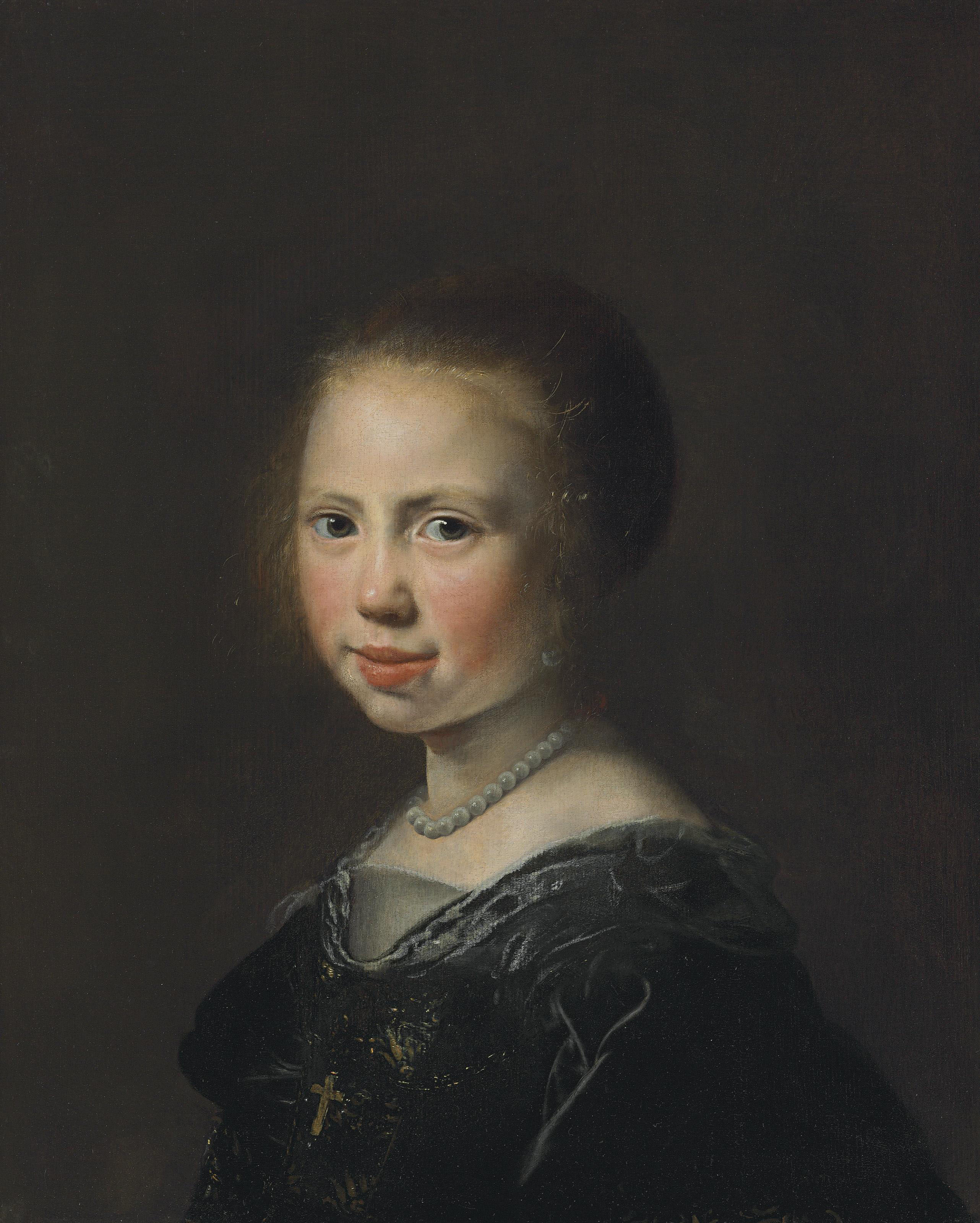 Portrait of a girl, bust-length, in a black dress and pearl necklace