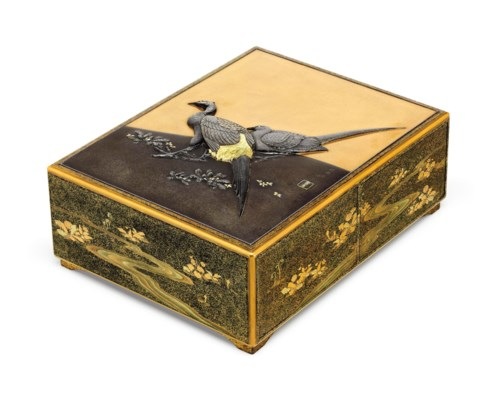 An inlaid mixed-metal lacquer