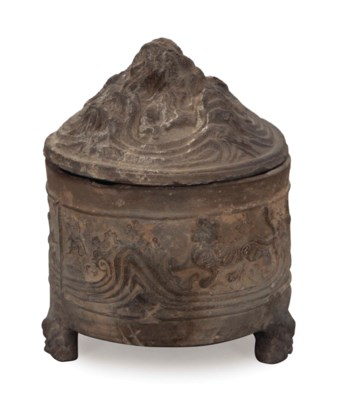 A CHINESE MOLDED GREY POTTERY