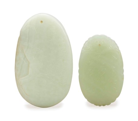 TWO CHINESE WHITISH JADE PENDA