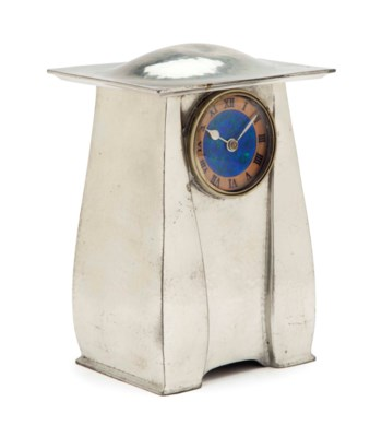 AN ENAMELED PEWTER TABLE CLOCK