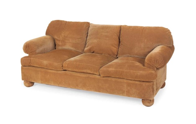 A BROWN PLUSH-UPHOLSTERED THRE
